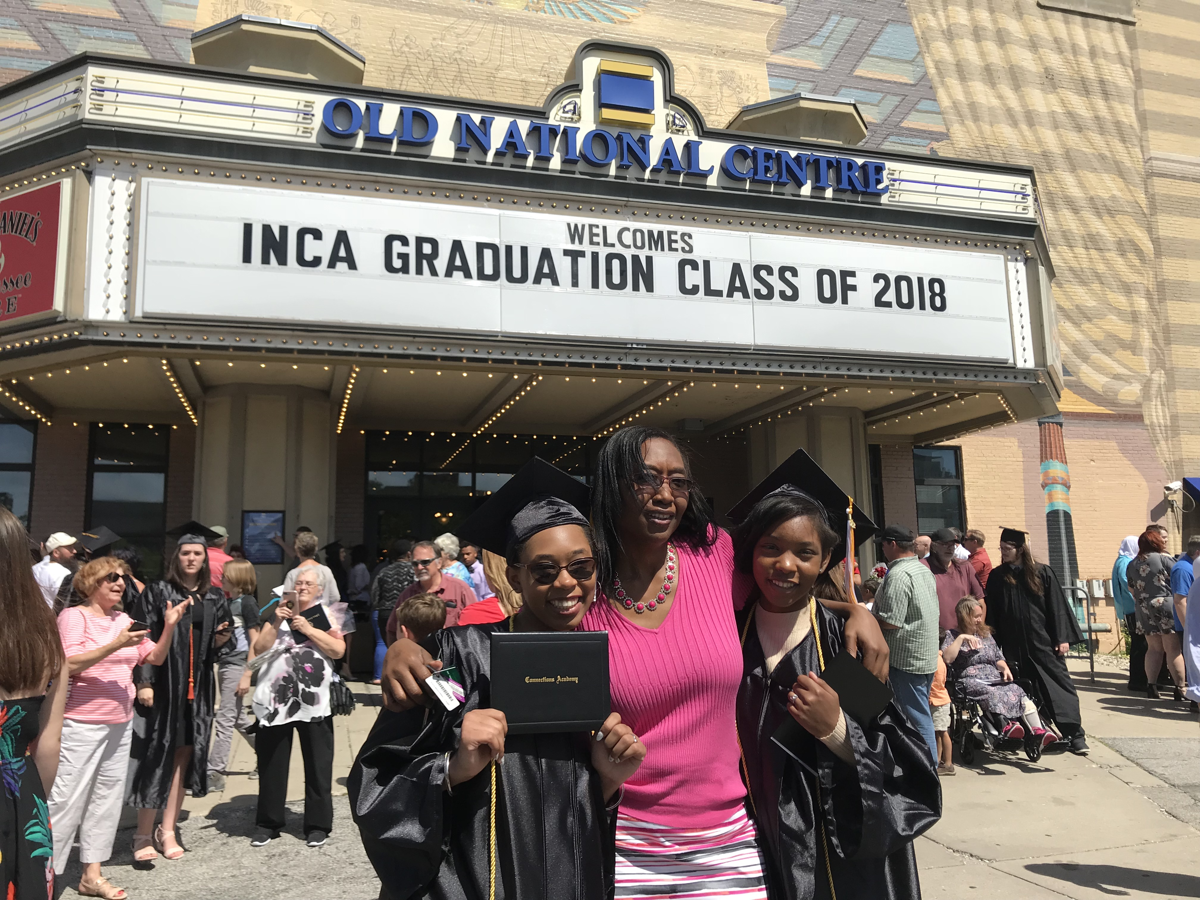 Angela Freel poses with her daughters, Dasani Freel and Cazariah Haskins, outside Old National Center. Dasani Freel and Haskins graduated Monday from Indiana Connections Academy.