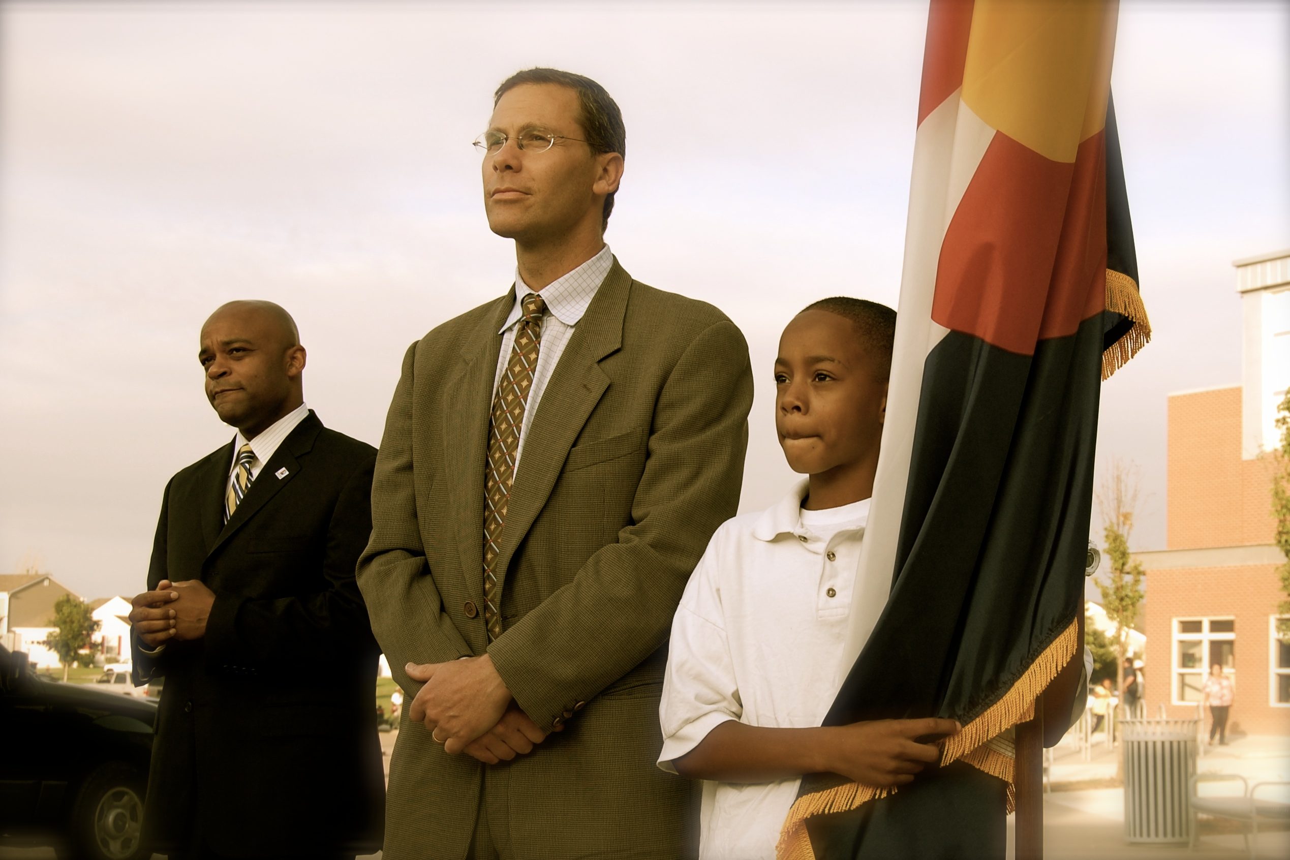 Denver Public Schools Superintendent Tom Boasberg, center, with Denver Mayor Michael Hancock and a DPS student on the opening day of school in 2011.