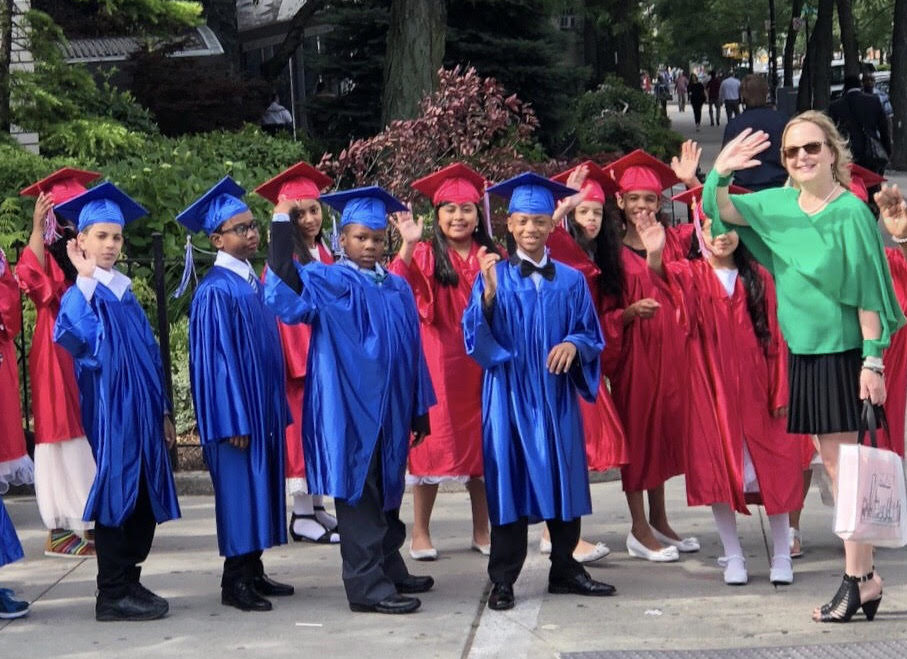 Kristin Erat with students graduating from Grant Avenue Elementary.