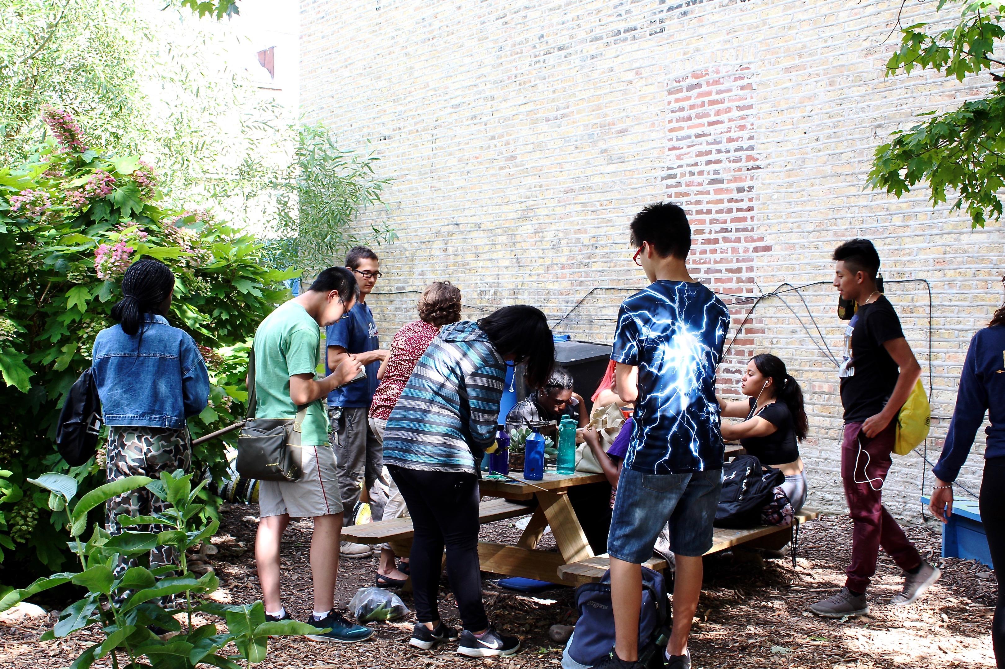 Teens gather in Jardin De Las Mariposas Garden for an After School Matters program