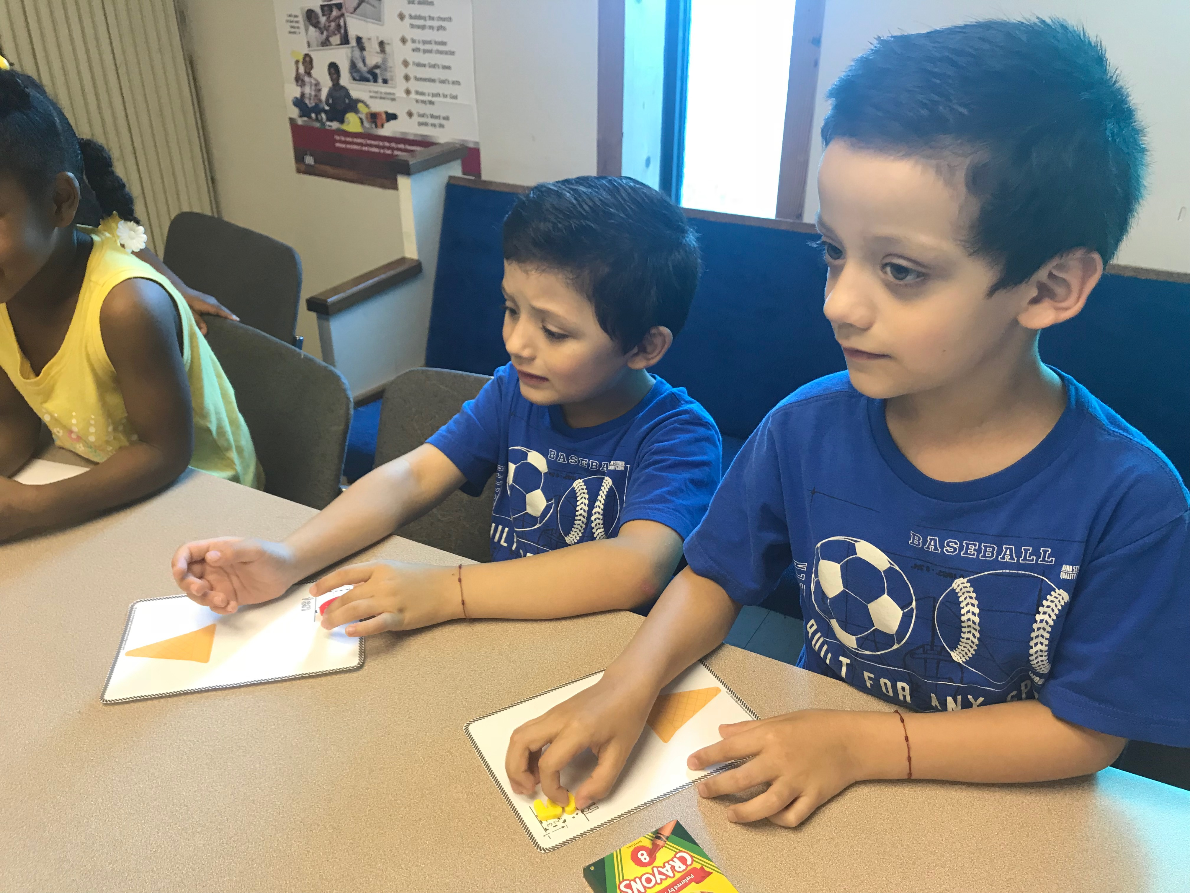 In this counting exercise, twin brothers, Rafael and Nicholas Gonzalez, prepare to stack pretend scoops of ice cream on their cones.