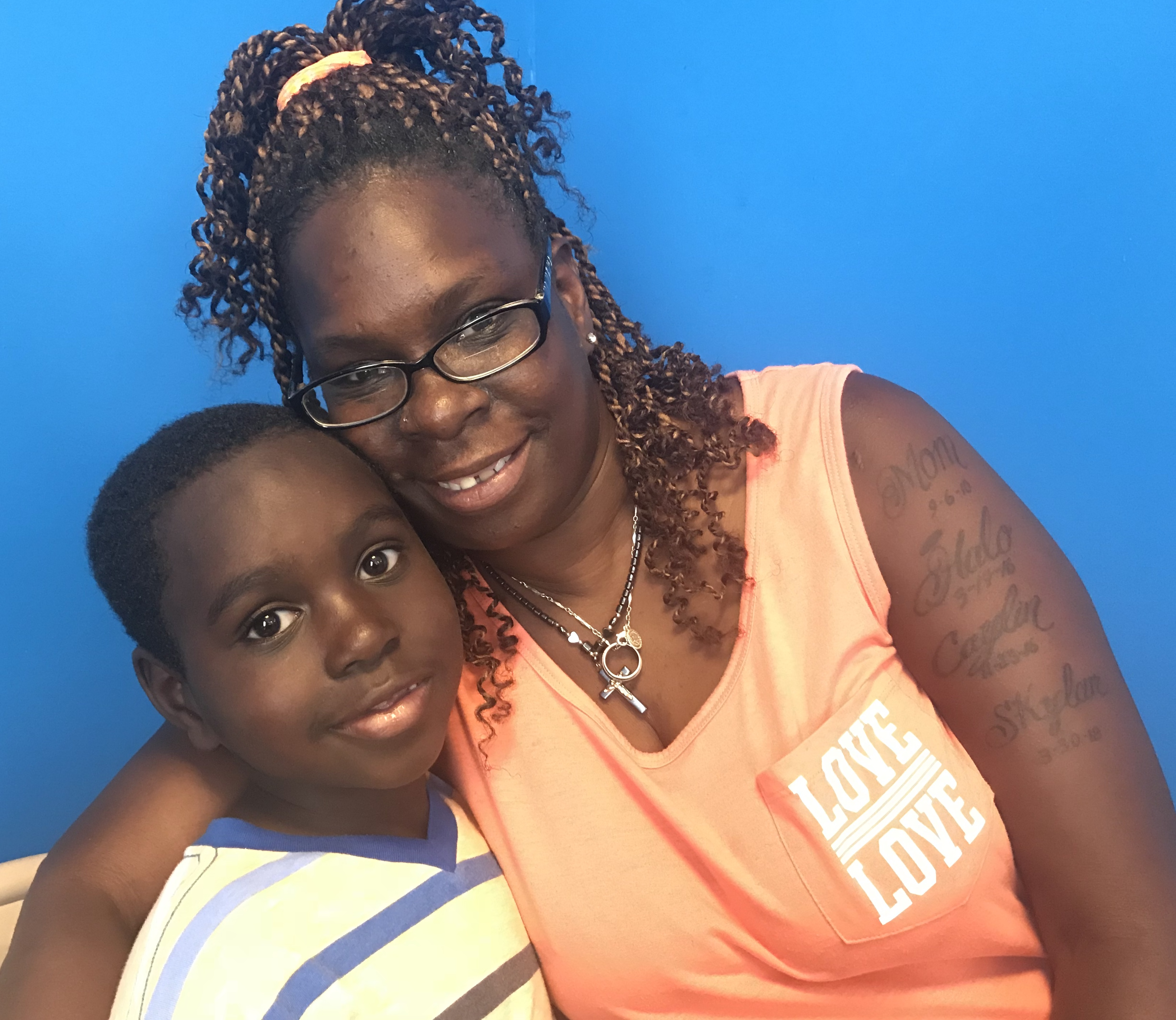 Michael McCall, 7, and his grandmother, Edna Paul, attended a meeting at the Detroit Parent Network to learn more about the third- grade reading law that will go into effect when he's in third grade.