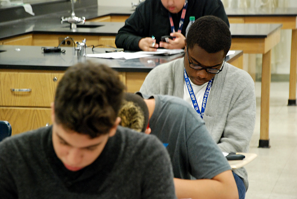 Students at Aurora Central High School work on an assignment during class during the spring of 2015.