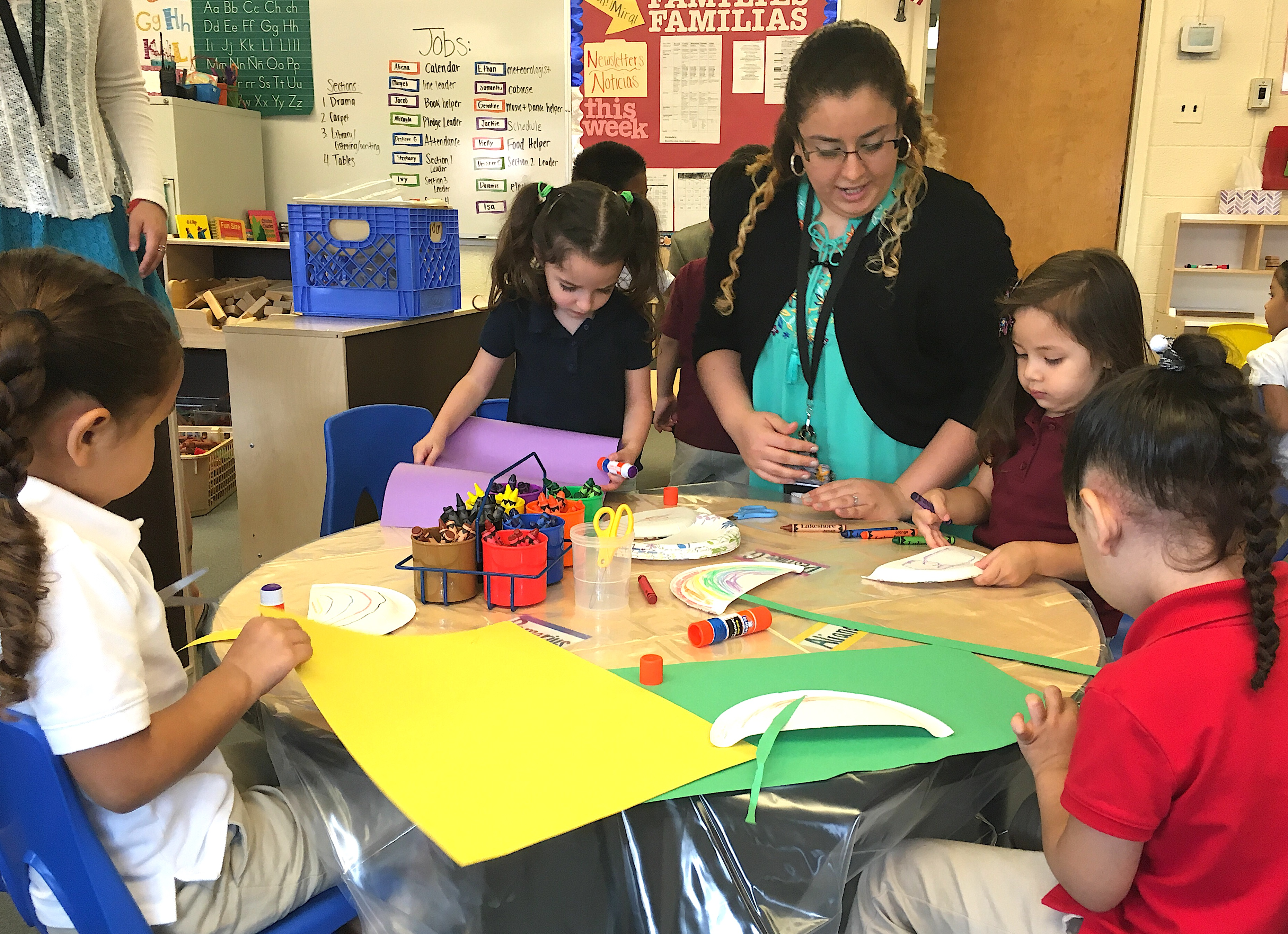 A staff member works with full-day preschoolers at Fairview Elementary School in 2016,