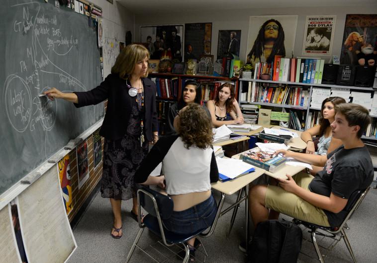 Wheat Ridge High School teacher Stephanie Rossi, left, teaches a sophomore AP U.S. History class.