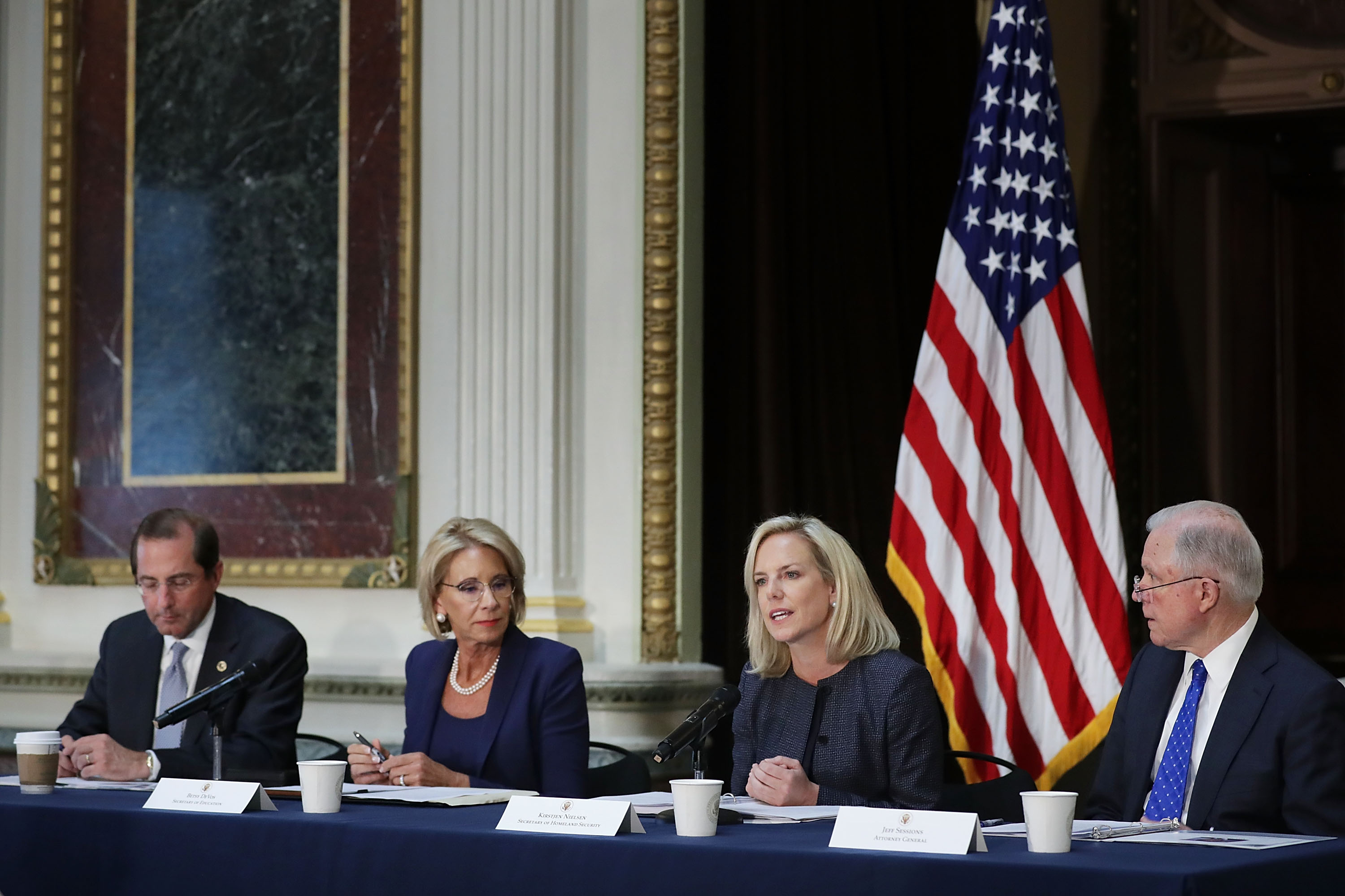 U.S. Health and Human Services Secretary Alex Azar, Education Secretary Betsy DeVos, Homeland Security Secretary Kirstjen Nielsen and Attorney General Jeff Sessions participate in a meeting of the Federal Commission on School Safety on August 16, 2018.   (Photo by Chip Somodevilla/Getty Images)
