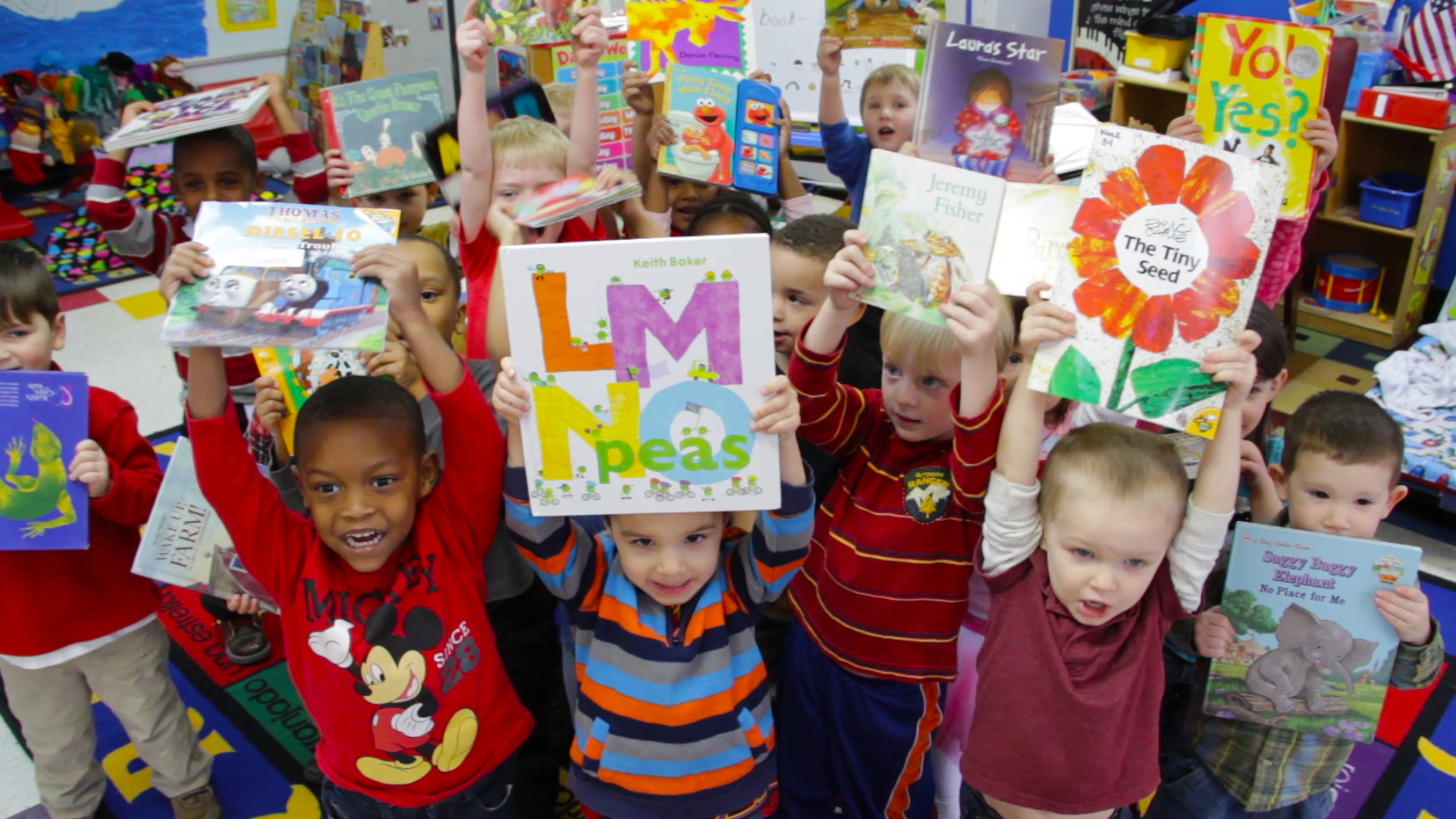Children at a Porter-Leath classroom show off their new books. Porter-Leath is the largest provider of early childhood education in Memphis.