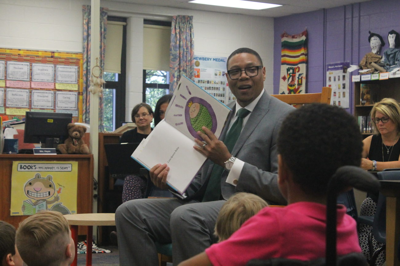 Superintendent Lewis Ferebee reads to children on the first day of school in 2017.