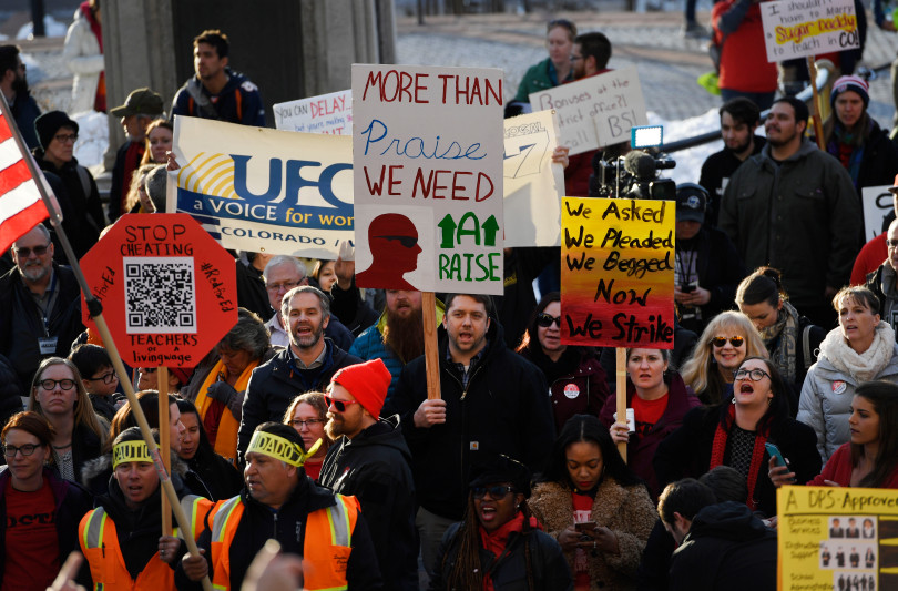 Denver Classroom Teachers Association teachers and supporters rally at the Colorado State Capitol on January 30, 2019, demanding better wages and urging the state not to get involved in a possible strike.