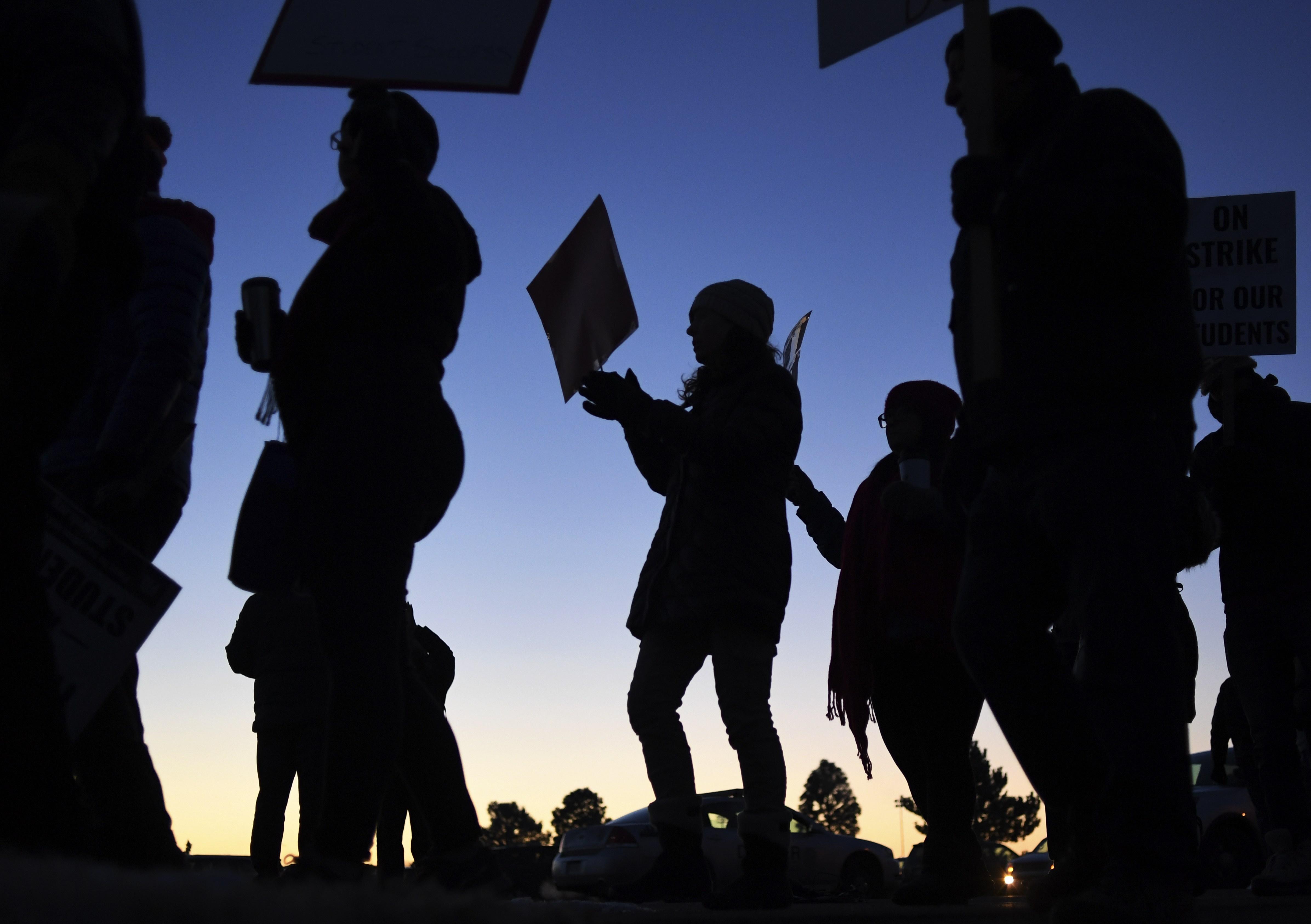 Denver teachers picket outside South High School on February 11, 2019.