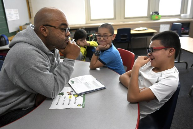 Third grade teacher Quincy Evans waits patiently for an answer from student Jonathan Bueno at Denver's Fairview Elementary on Jan. 23, 2019.
