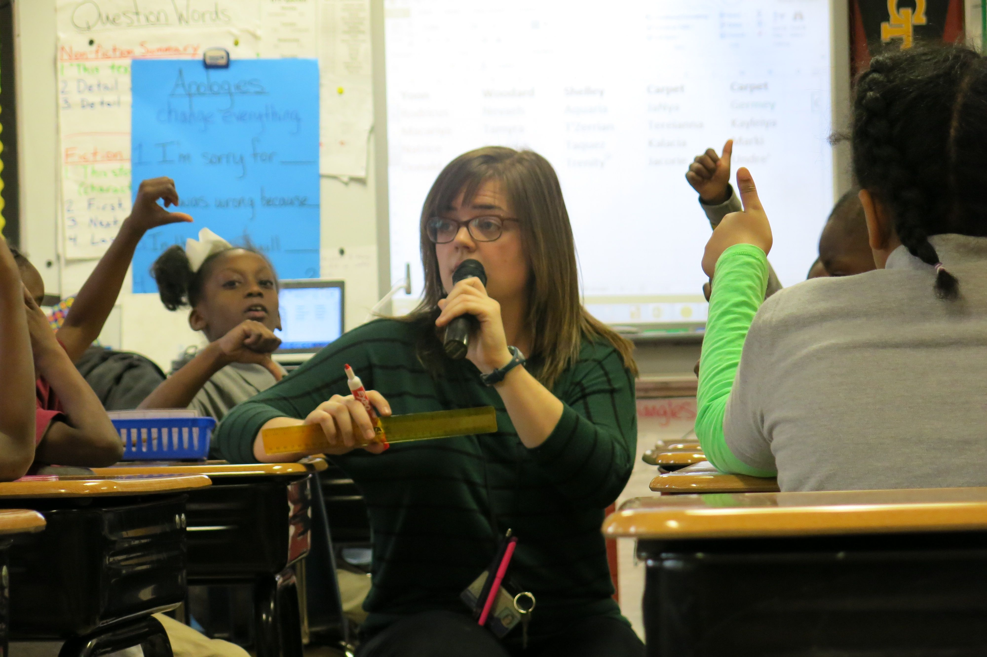 Second-grade teacher Katelyn Woodard uses a wireless microphone and amplifier to project her voice during class on Jan. 13, 2015, at Cornerstone Preparatory School in Memphis.