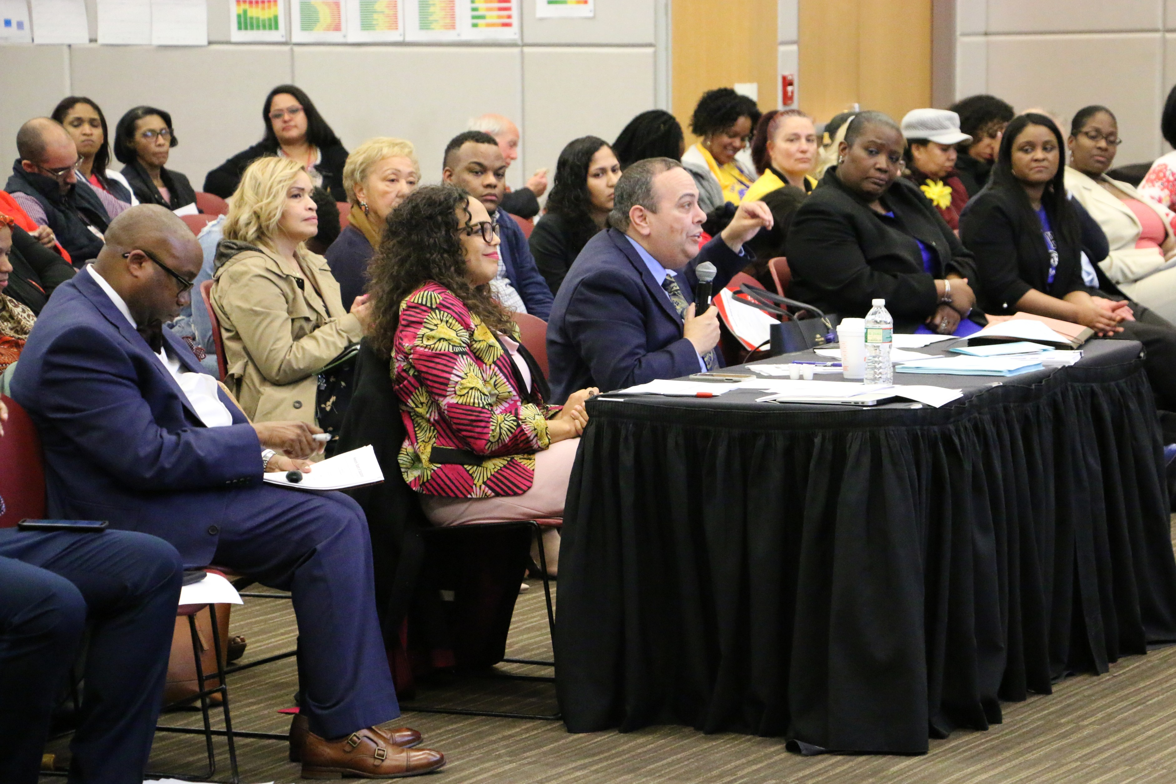 Superintendent Roger León, center, received recommendations for his district plan this week.