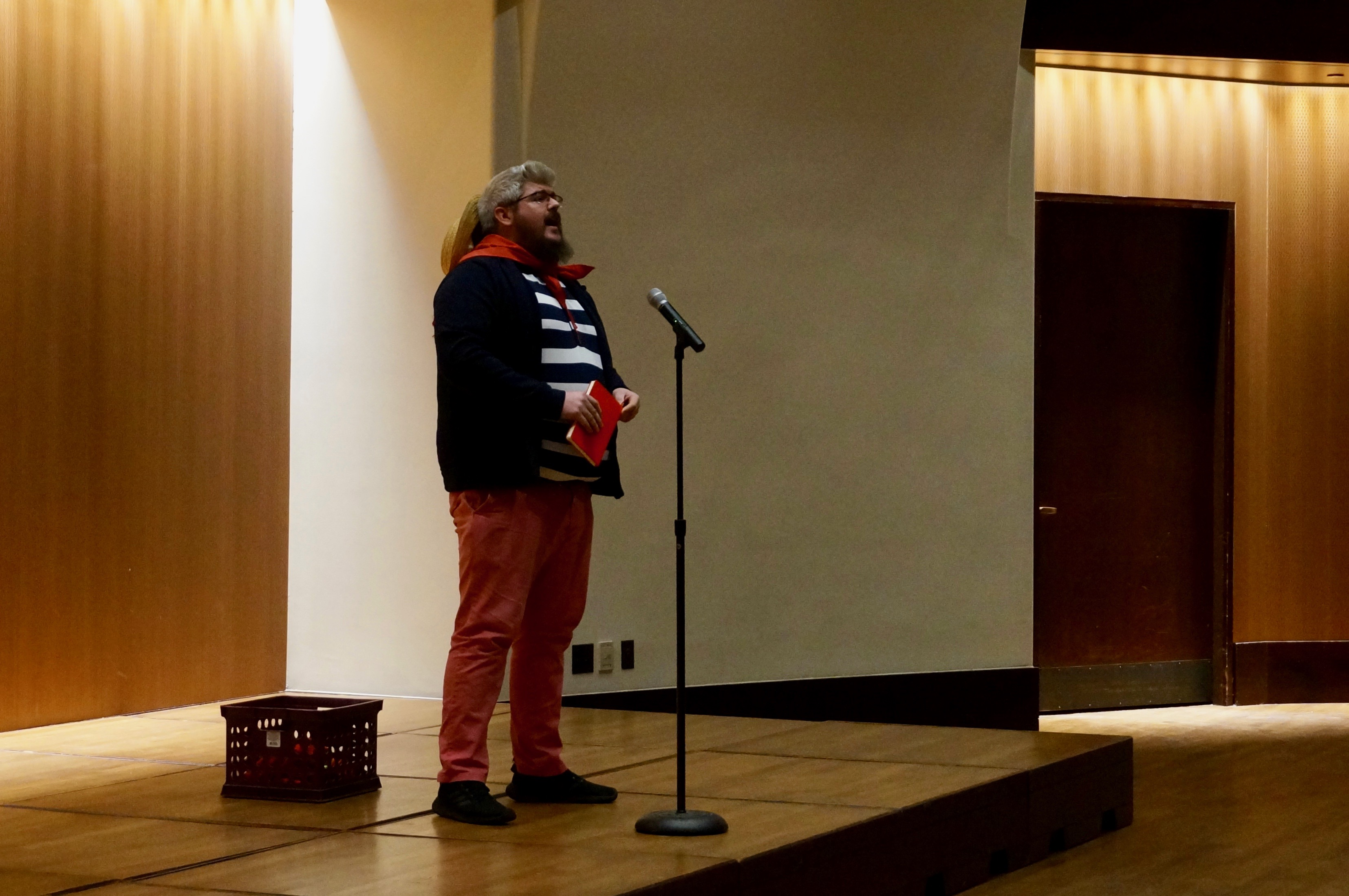 Derek Gould, a teacher at Paramount Brookside, talked about his second job as a singing gondolier at a story slam on teacher pay.