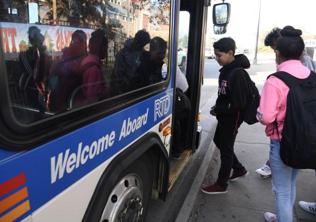 High schoolers in Denver take public buses to school.