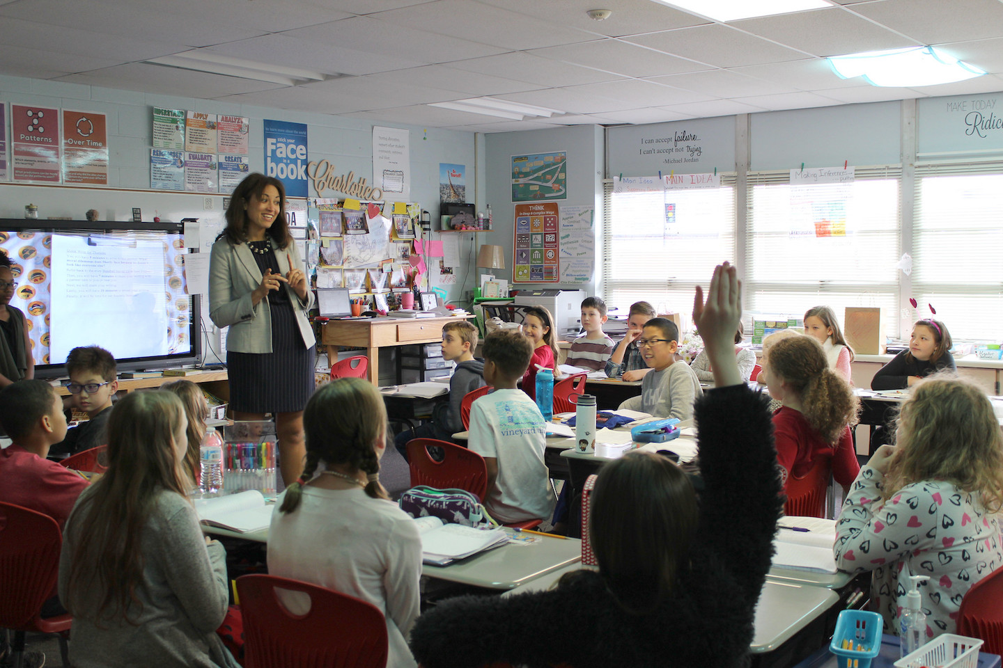 Penny Schwinn talks with students in Rutherford County at one of more than 175 classrooms she's visited since starting as Tennessee's education commissioner in February. (Photo courtesy of the Tennessee Department of Education)