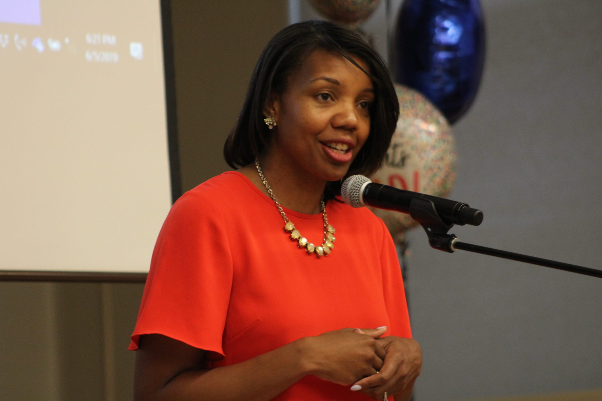 IPS Interim Superintendent Aleesia Johnson delivers a keynote speech at the graduation ceremony for her district's fifth Stand University for Parents class.