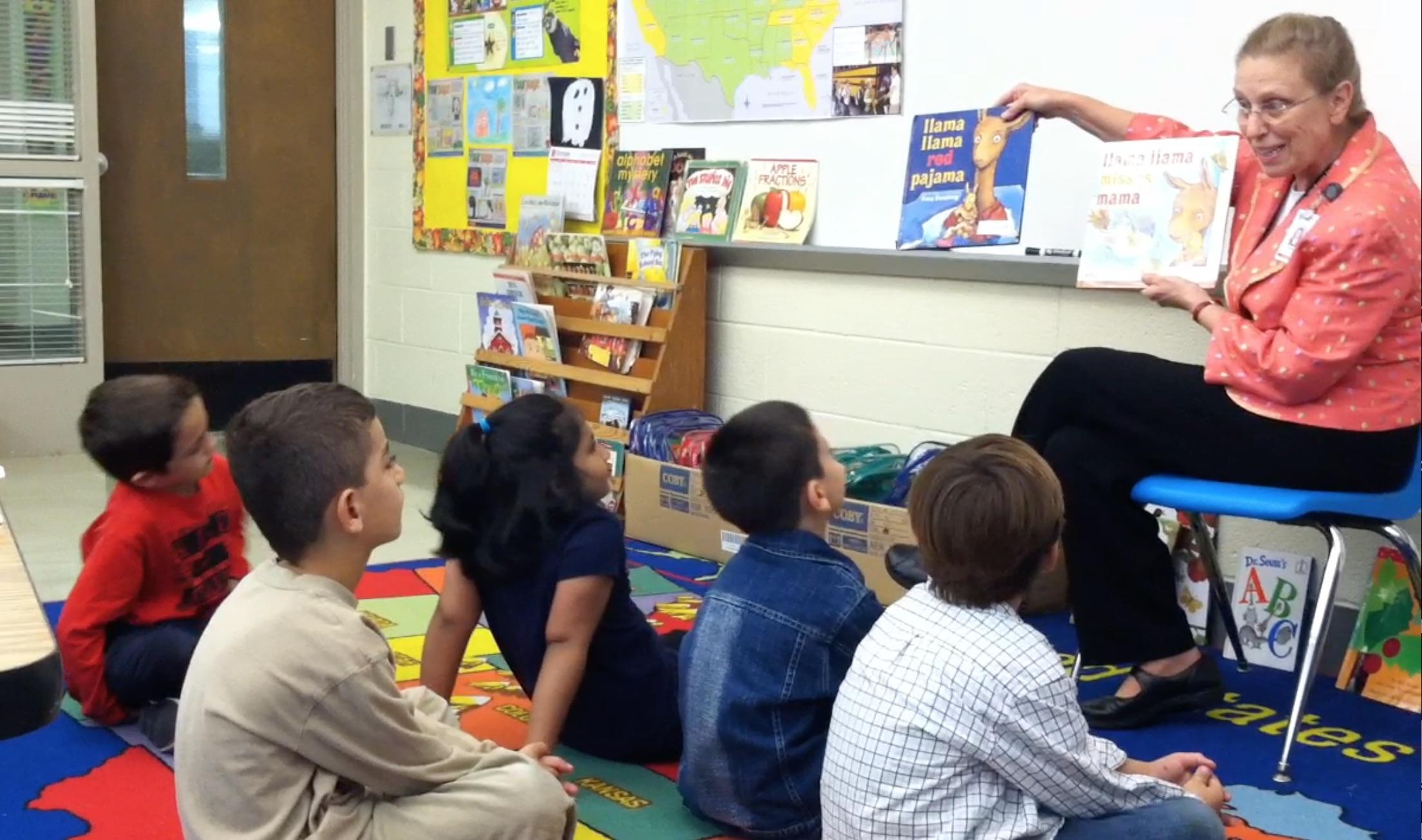 A retired teacher, Barbara Gottschalk, reads aloud.