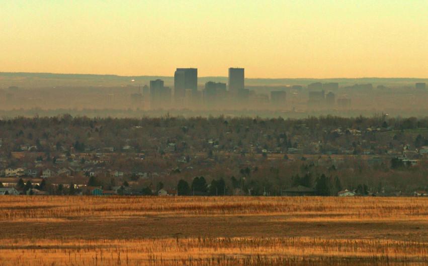 A brown cloud obscures the Denver skyline.