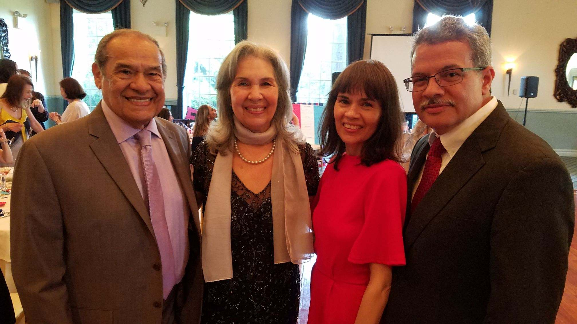 Elizabeth Mendoza, second from left, with family members at her retirement party.
