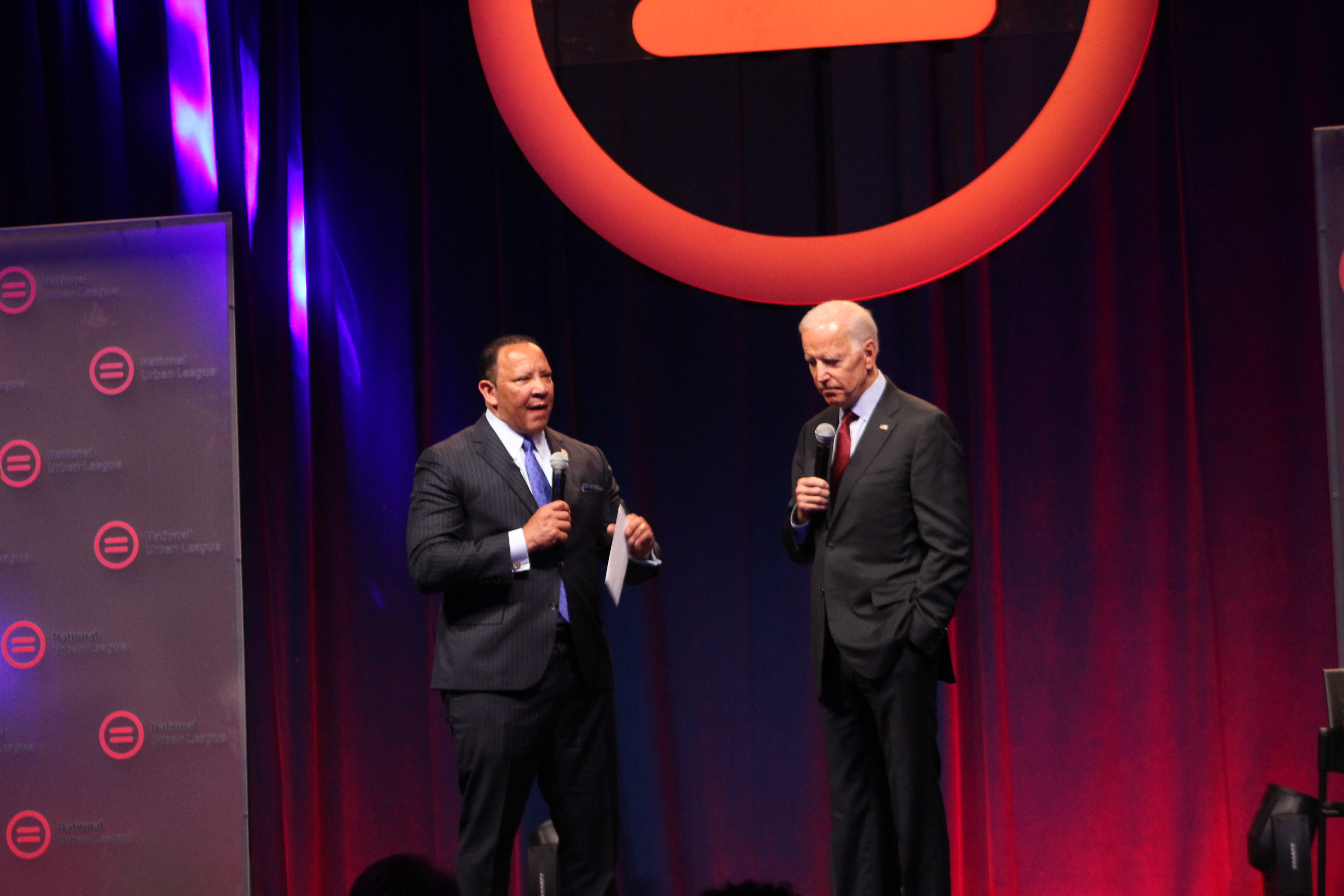 Former vice president Joe Biden speaks with National Urban League President Marc Morial at the organization's conference Thursday in Indianapolis.