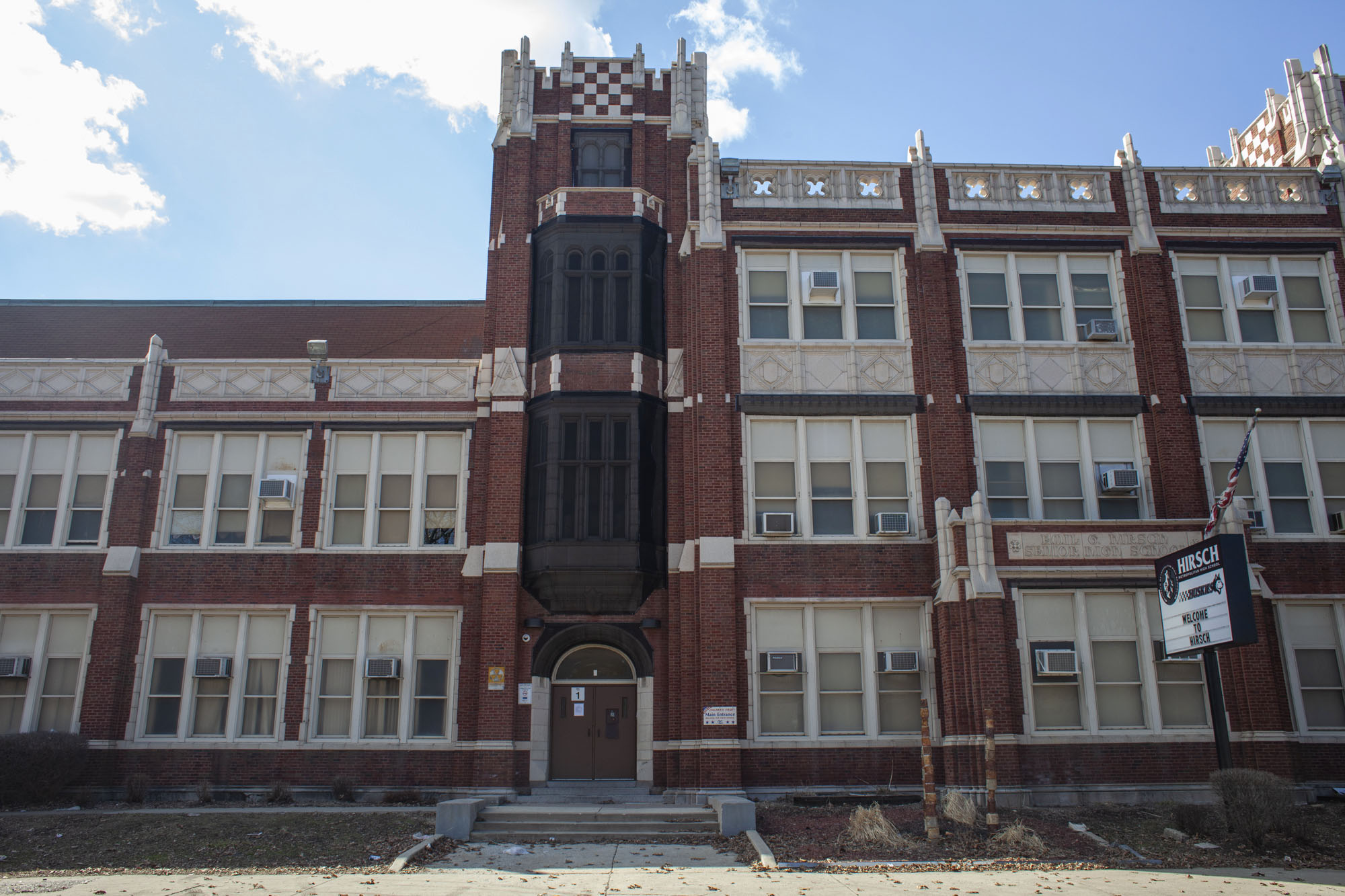 """Exterior view of Emil G. Hirsch Metropolitan High School, a public 4–year high school located in the Greater Grand Crossing neighborhood on the south side of Chicago. Hirsch is an underenrolled high school and one of the recipients of the school district's """"equity grants"""" for schools with low enrollment."""