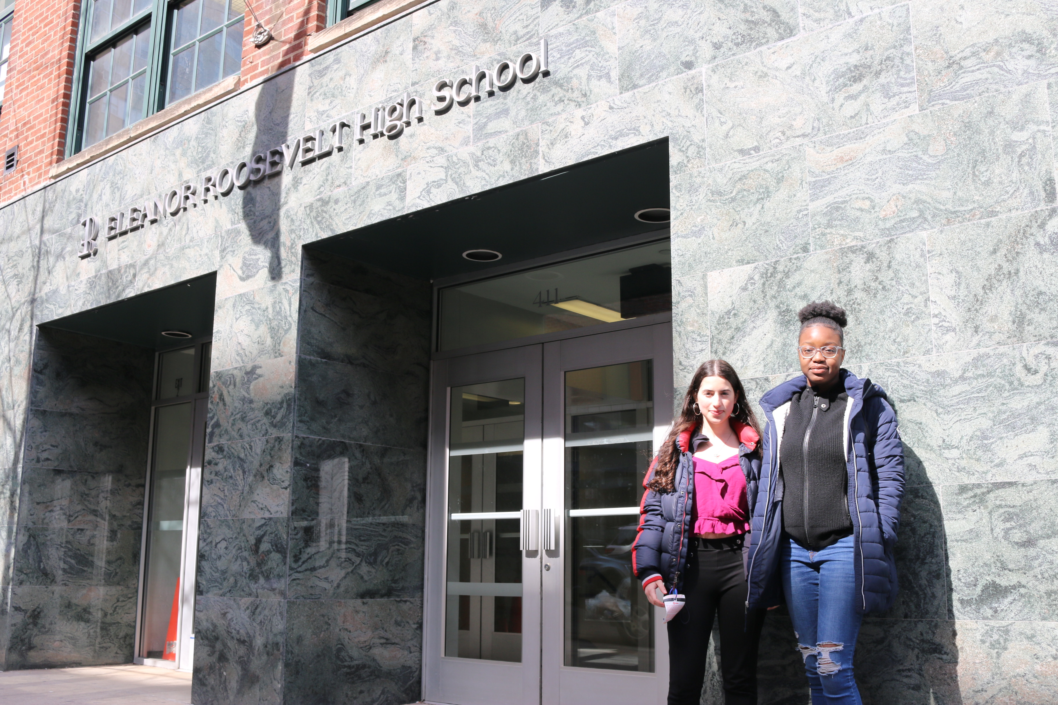 Students stand in front of Eleanor Roosevelt High School, which has one of the most rigorous academic screens for admission in the city.