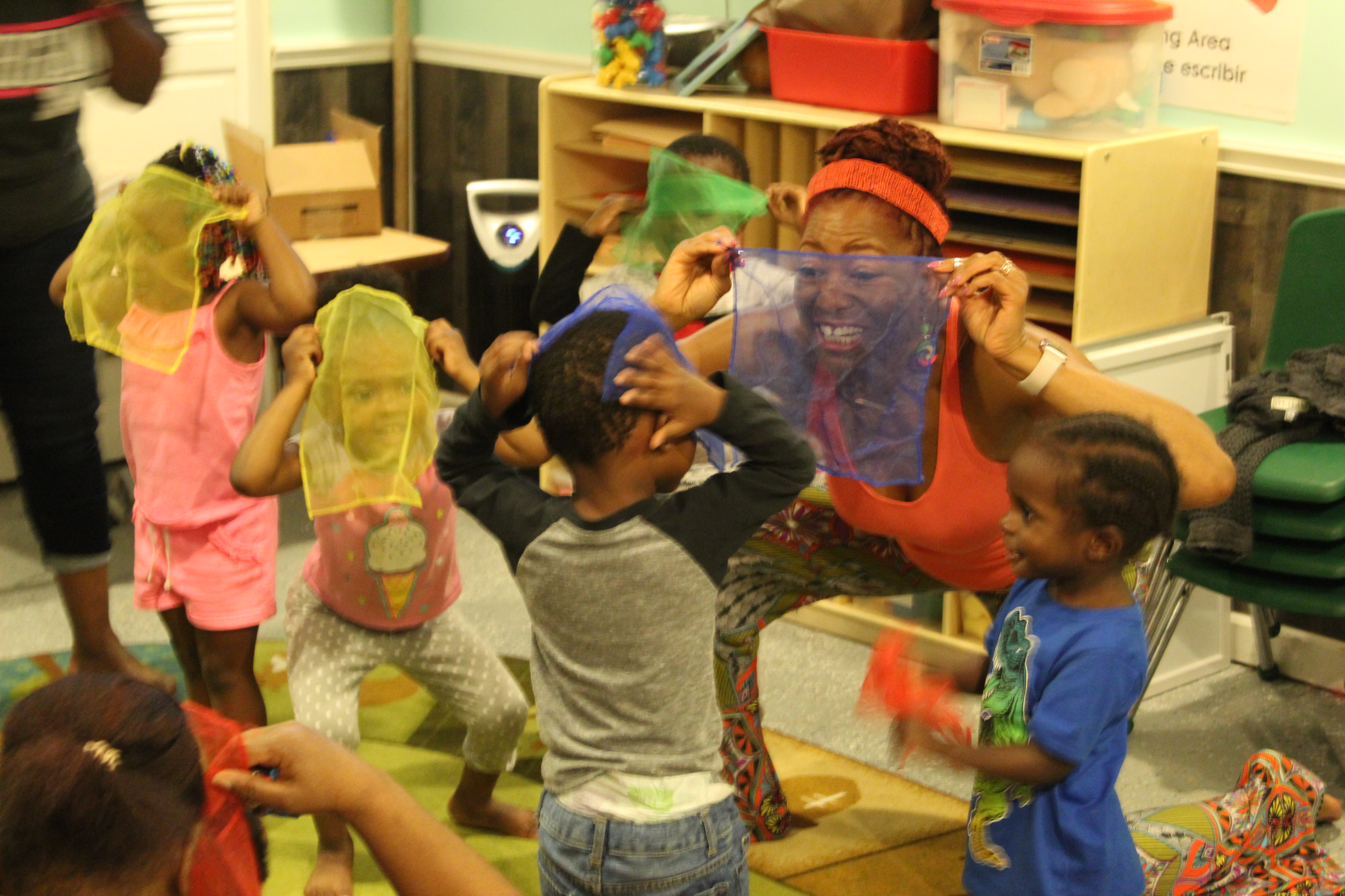 Kimberli Boyd, a working artists, teaches young children about rhymes and primary colors using scarves.