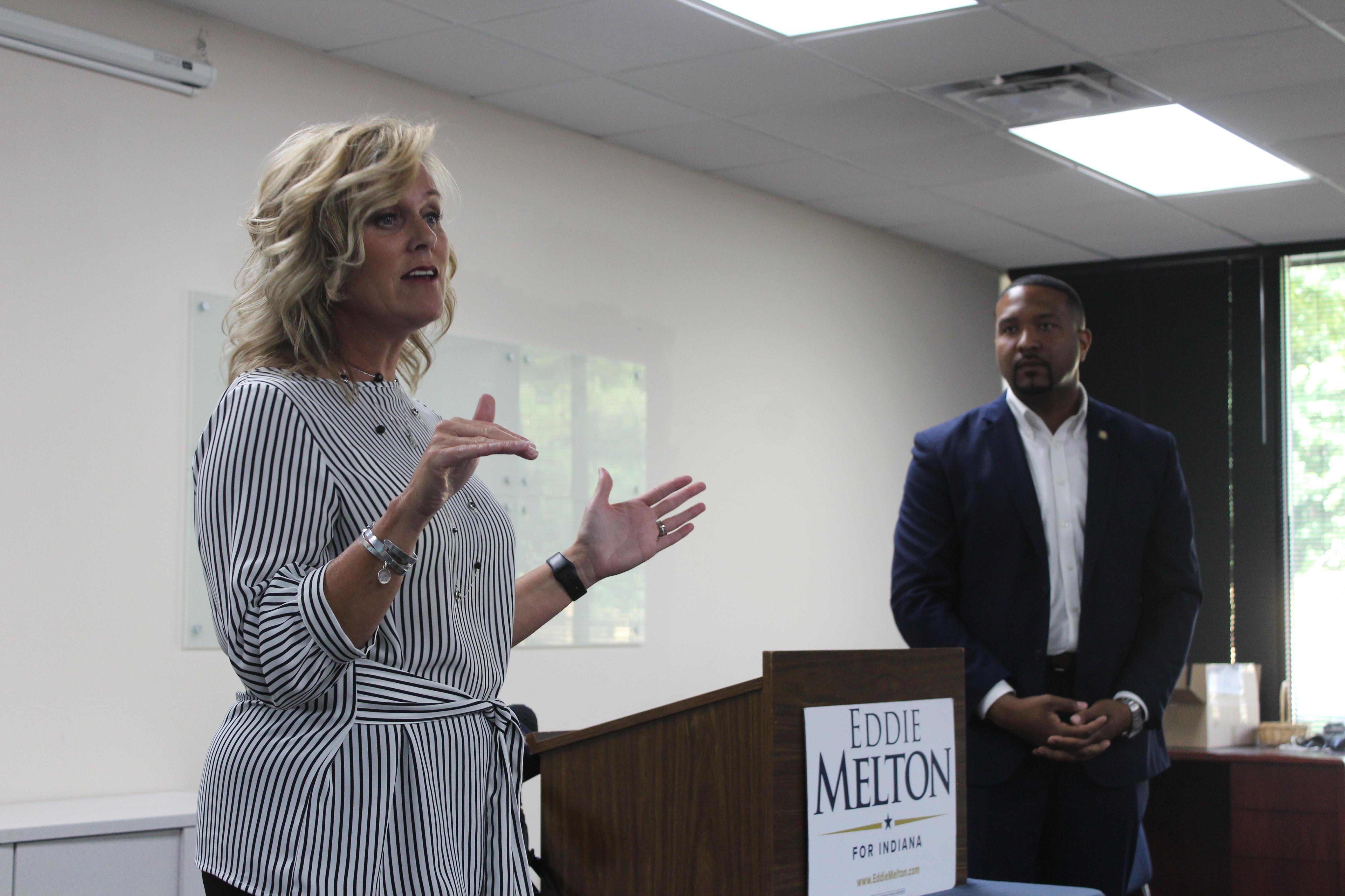 State Superintendent Jennifer McCormick speaks alongside State Senator Eddie Melton in July at their community conversation in Indianapolis.