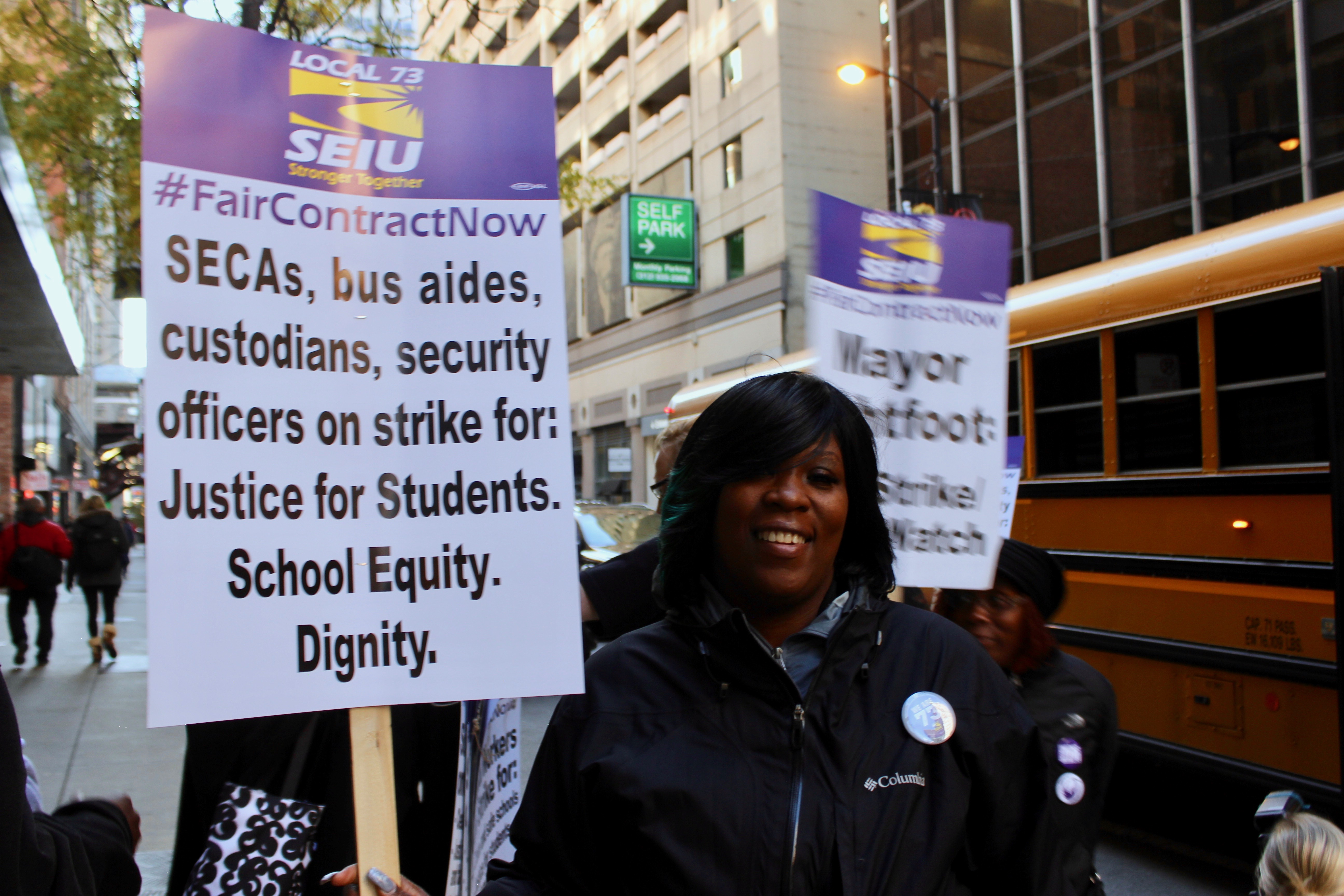 Chicago Public Schools custodial worker Tashanna Johnson prepares for a joint SEIU Local 73 and Chicago Teachers Union rally downtown on Oct. 23, 2019.