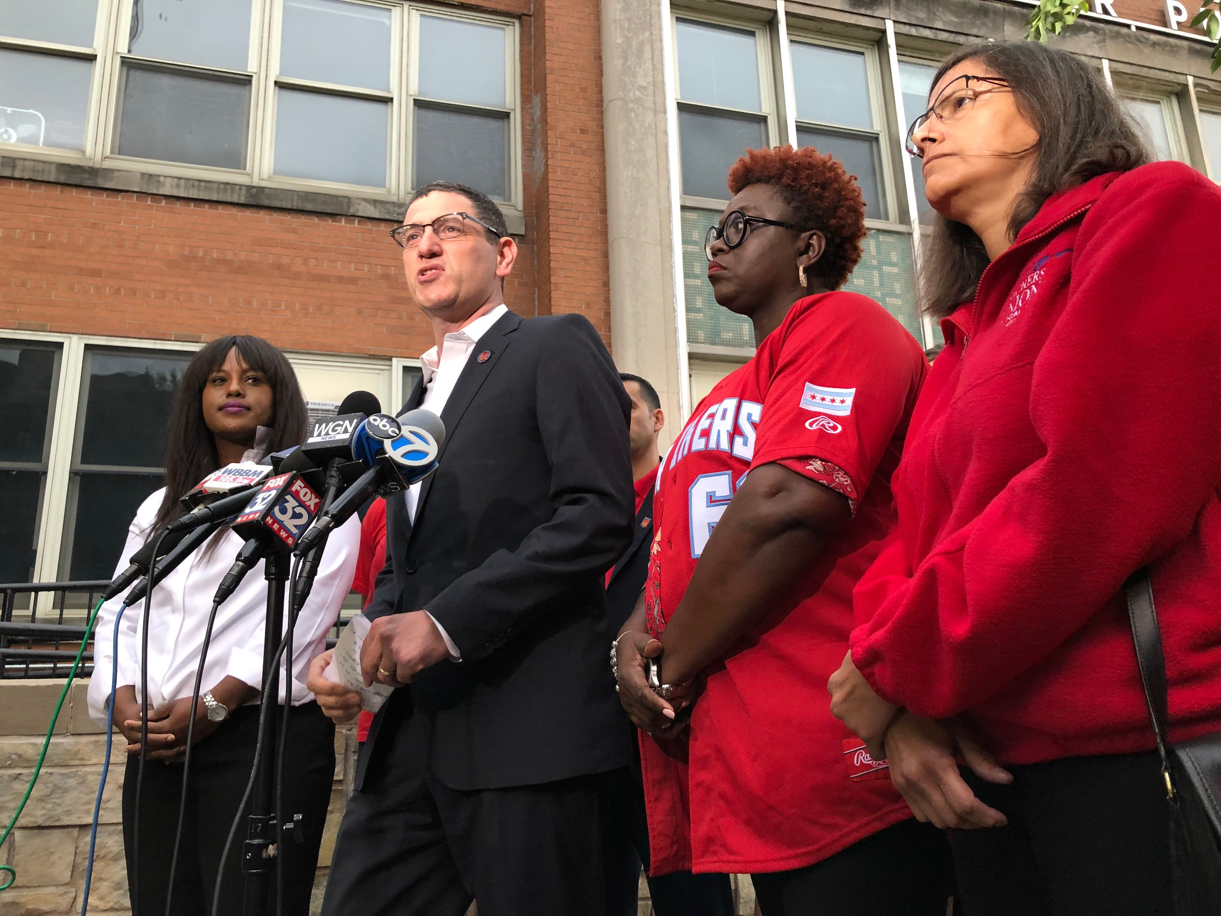 Jesse Sharkey, president of the Chicago Teachers Union, spoke in August 2019 at a press conference after the union rejected a neutral fact-finder's proposal, officially launching a countdown to a strike.