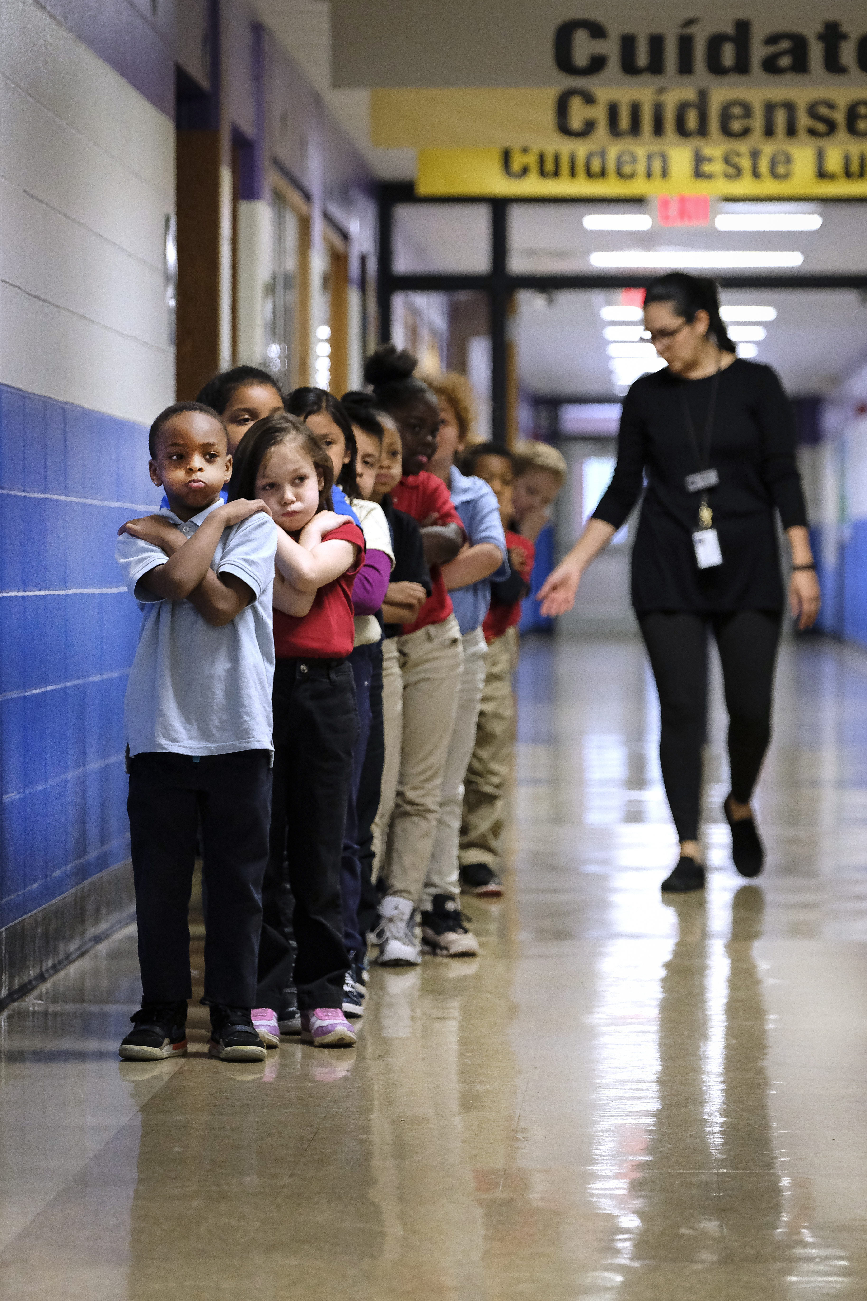 Students in a line in a hallway at Thomas Gregg Neighborhood School, an elementary school in Indianapolis, Indiana. —April, 2019— Photo by Alan Petersime/Chalkbeat