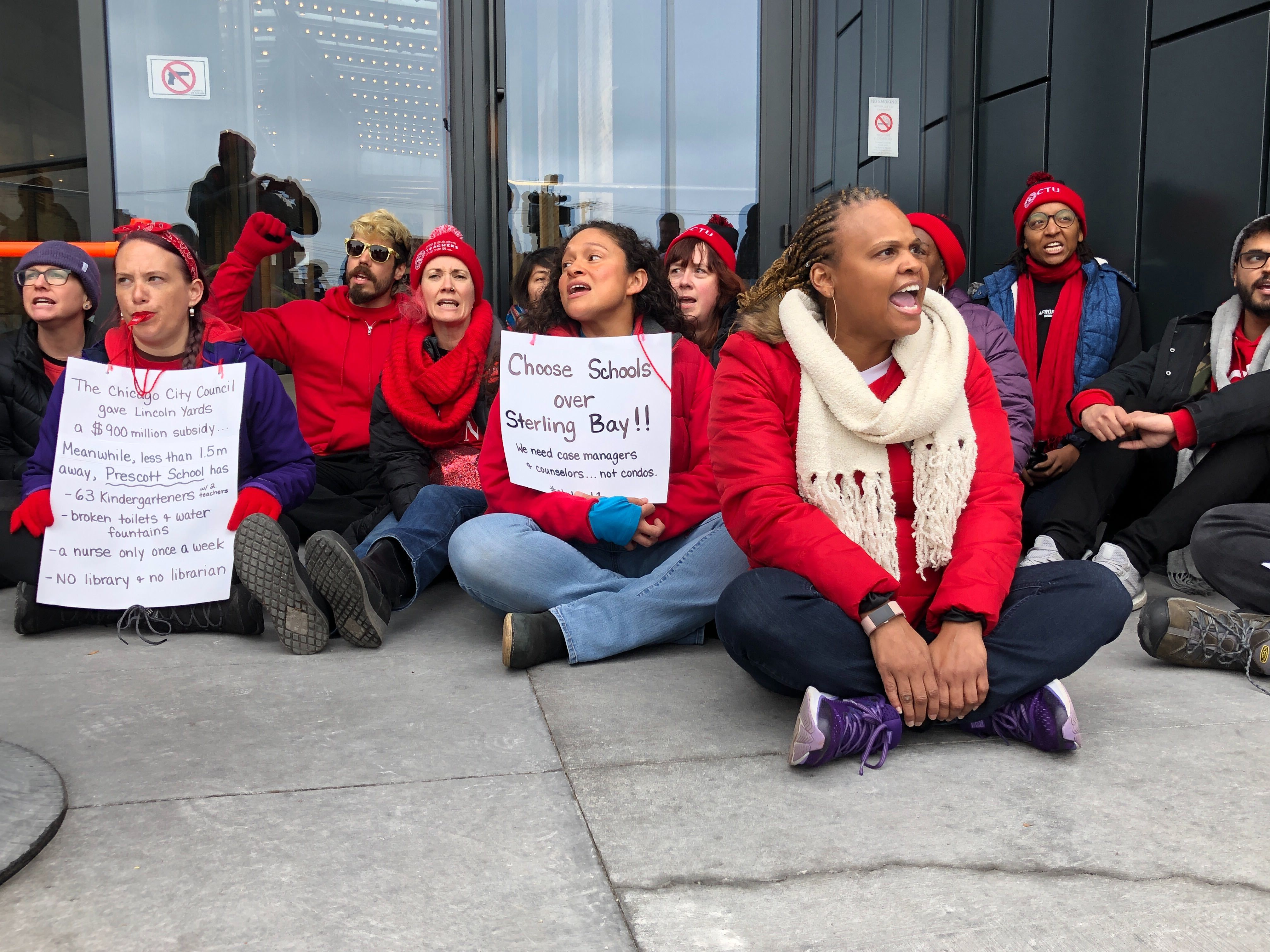 About 40 CTU members protested outside the West Loop headquarters of Lincoln Yards developer Sterling Bay on the ninth day of a citywide teacher strike. The teachers sought to deliver a letter highlighting the use of tax incentives for the development.