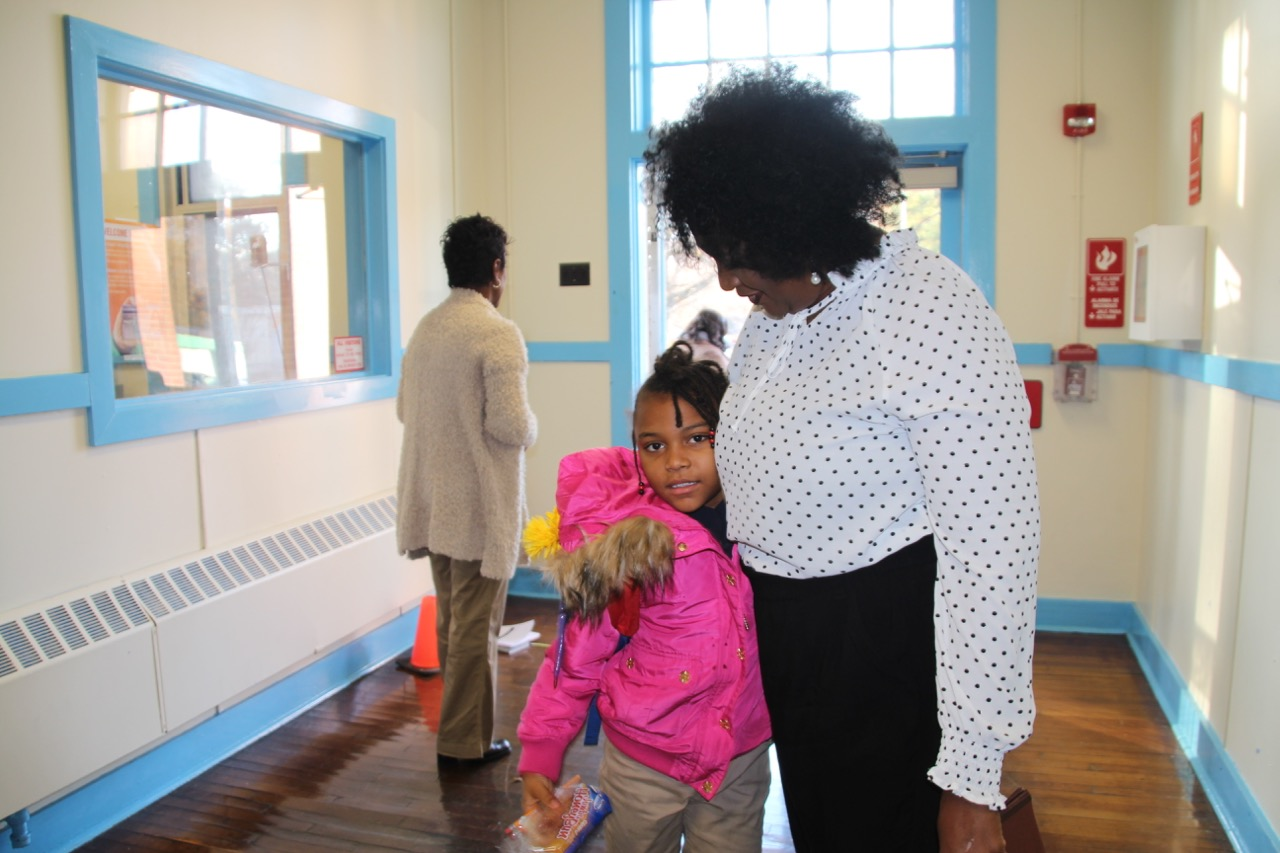 A student greets a staff member at Georgian Hills Achievement Elementary School, one of three schools that could return to local control in 2020.