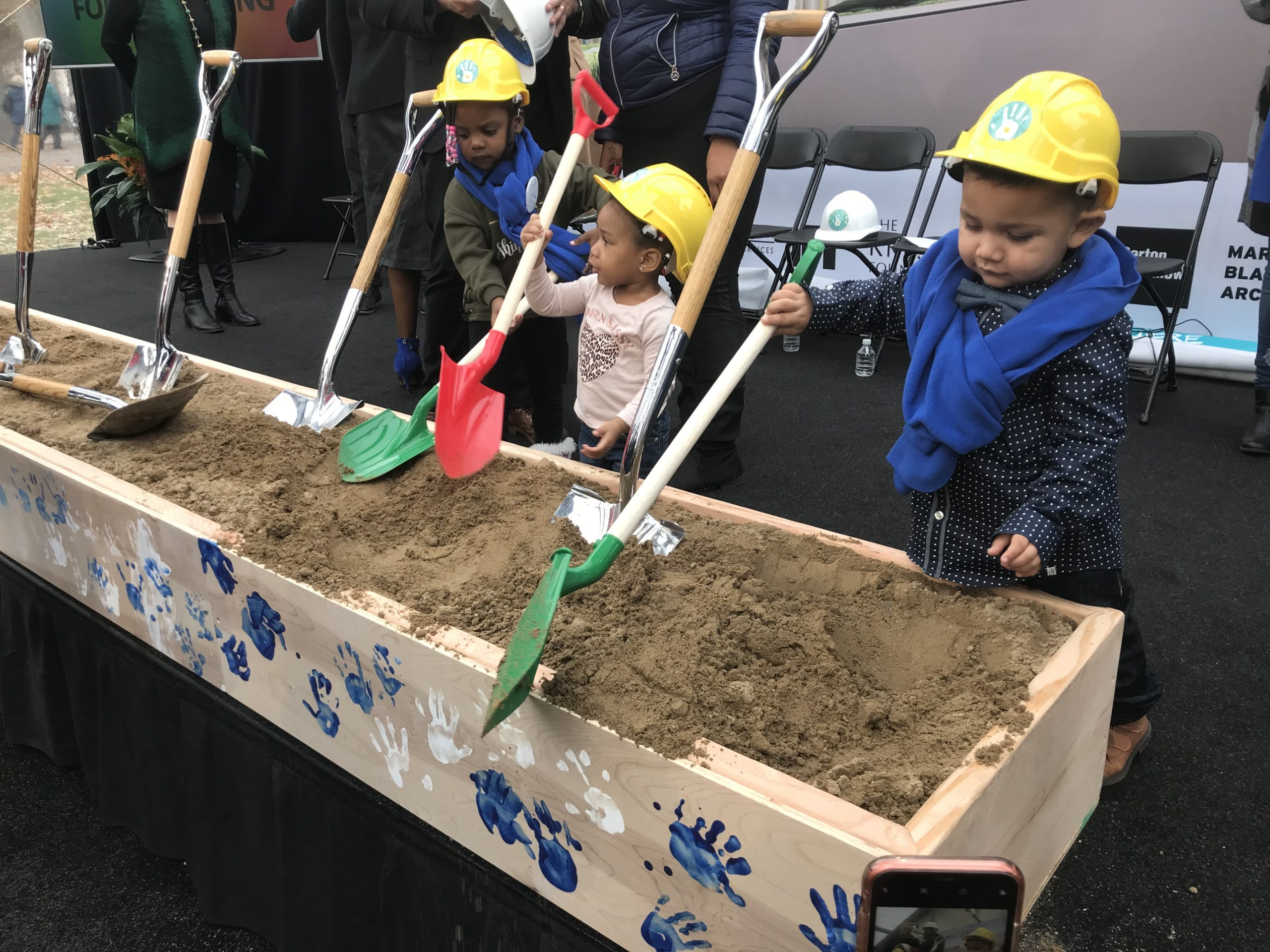 Preschool children do their part during a ceremonial groundbreaking event for a new early childhood education center at Marygrove College.