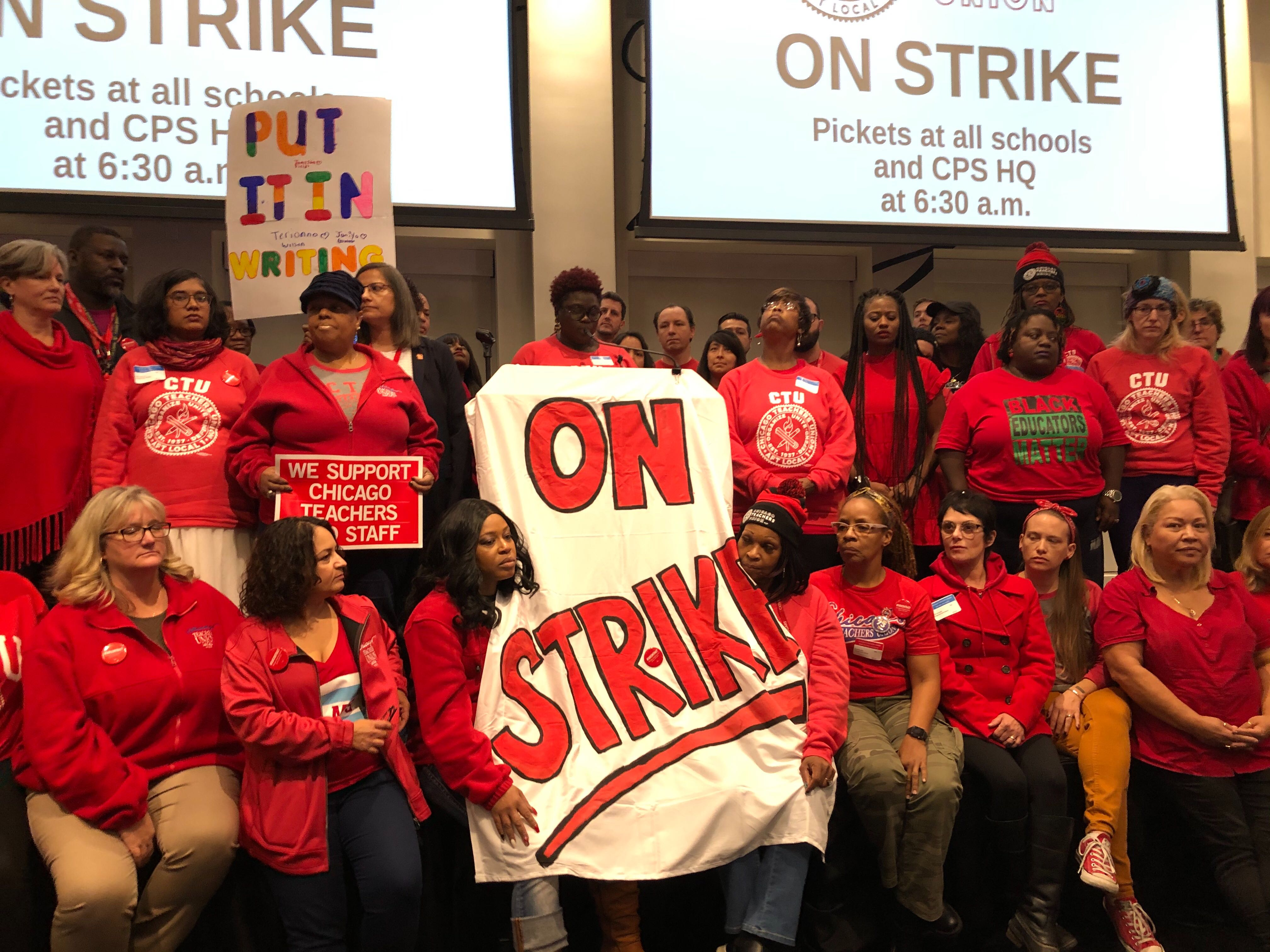 Chicago Teachers Union delegates face news media after voting Oct. 16, 2019, at union headquarters to authorize a strike.