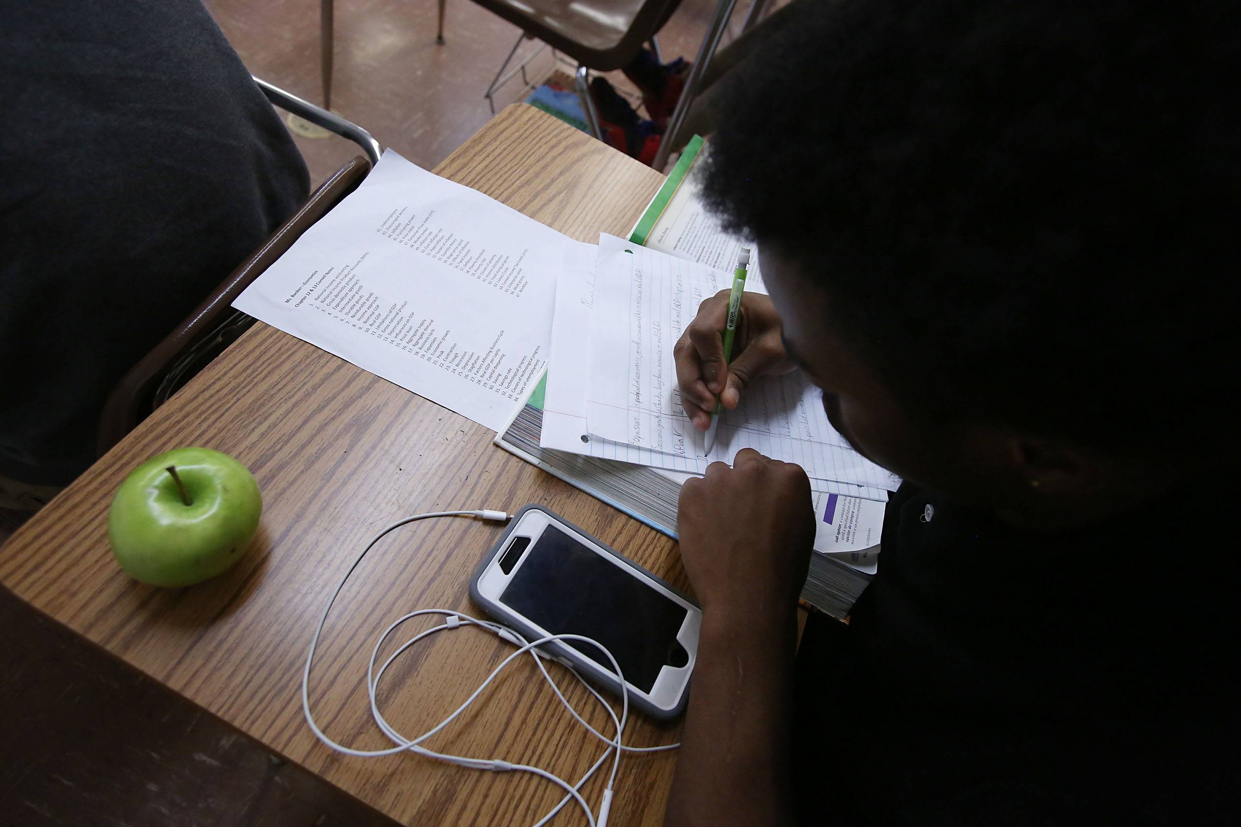 A student works at a desk in a classroom at Hillcrest High School in Memphis – one of five high schools in the Achievement School District.