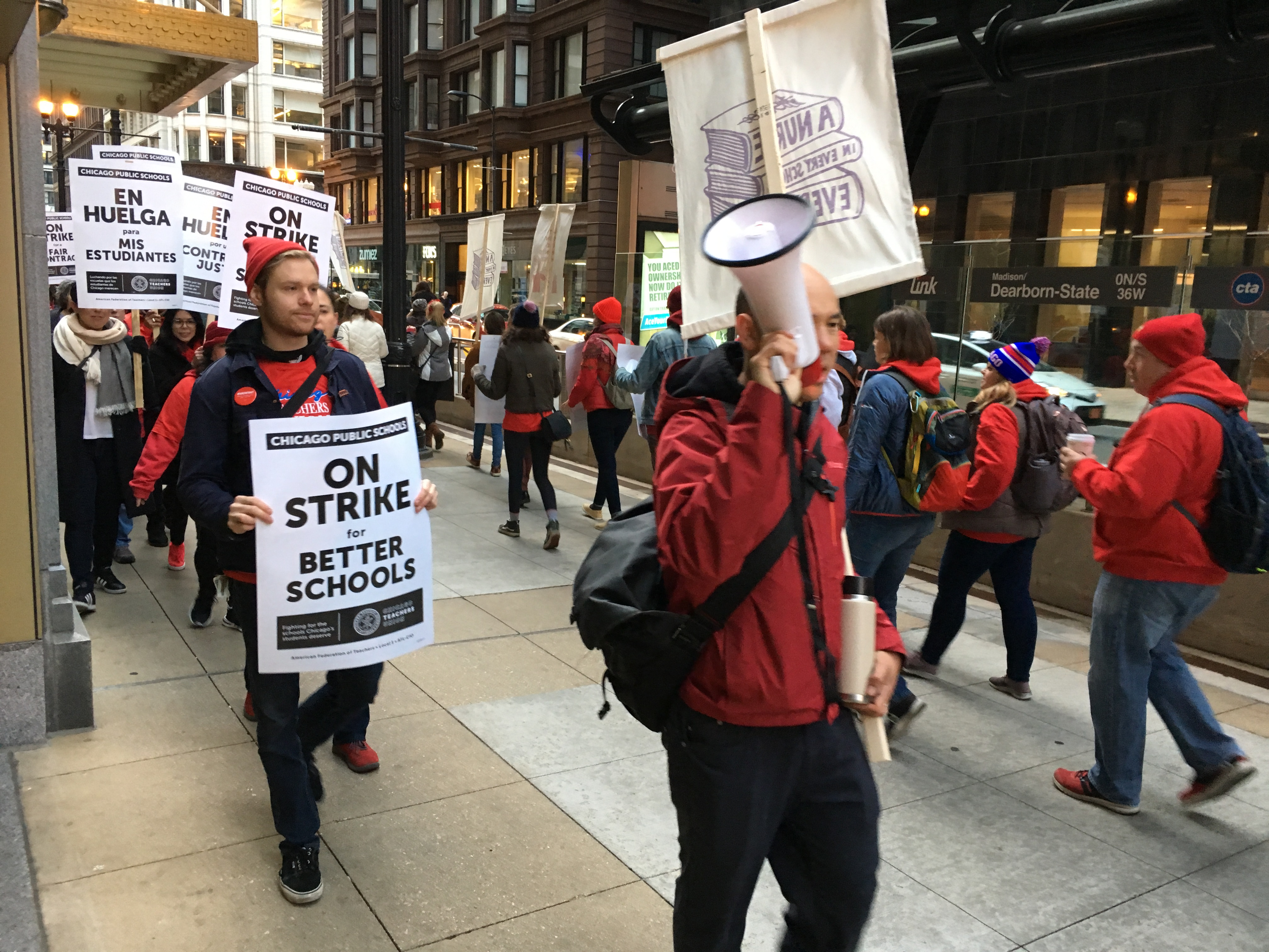 Chicago Teachers Union members picketed in downtown Chicago on the first day of the union's strike.