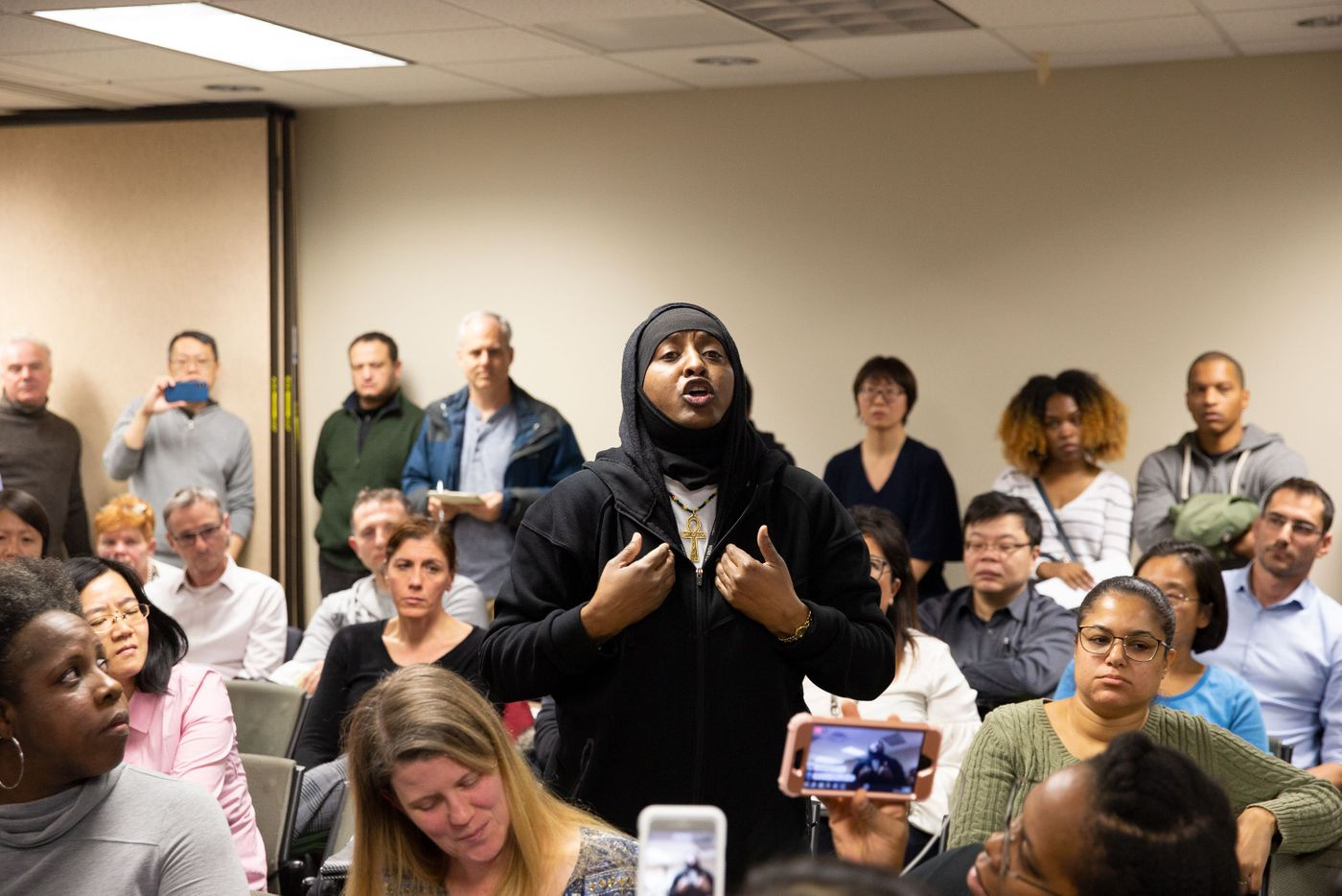 Parent Lorraine Reid argued for more resources for schools serving mostly children of color at a public meeting to discuss plans to integrate District 28 middle schools.