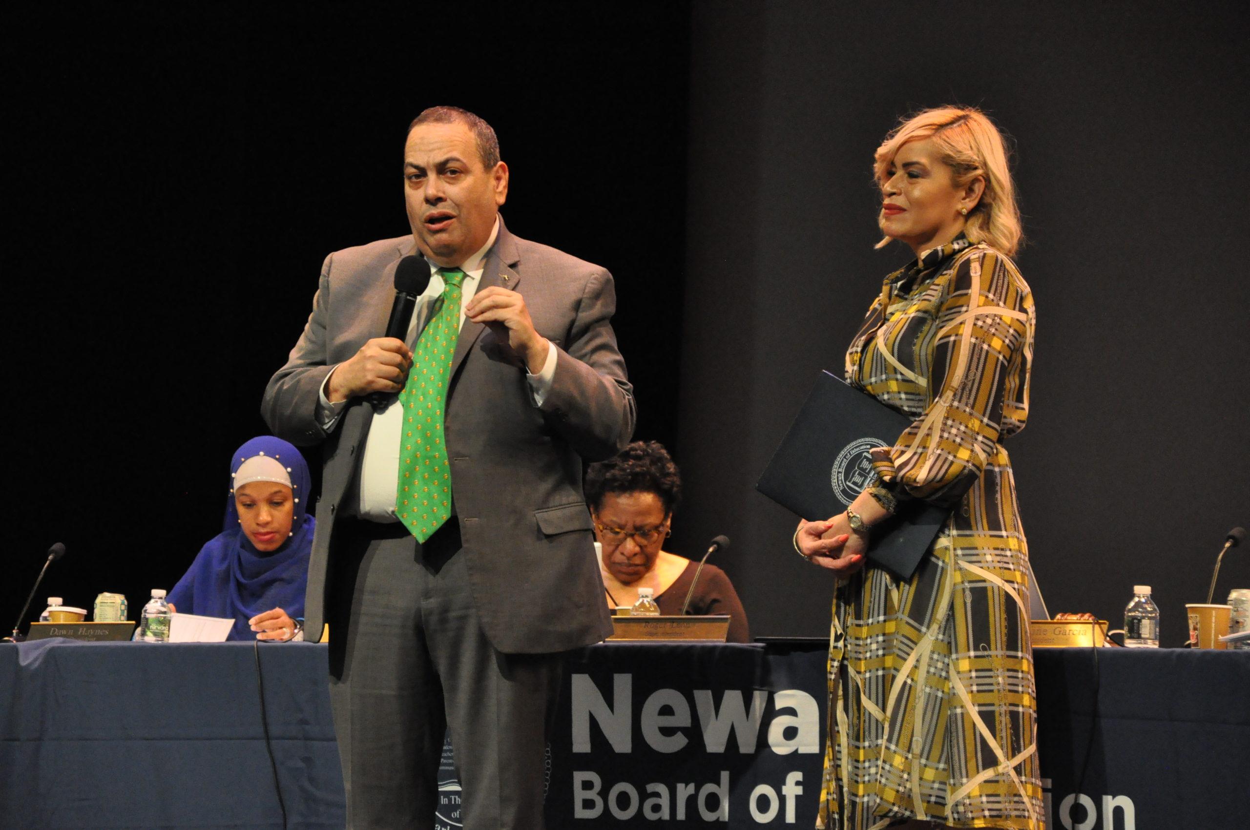 Newark superintendent Roger León, alongside board president Josephine Garcia, addresses the crowd at the November 26, 2019, school board meeting.