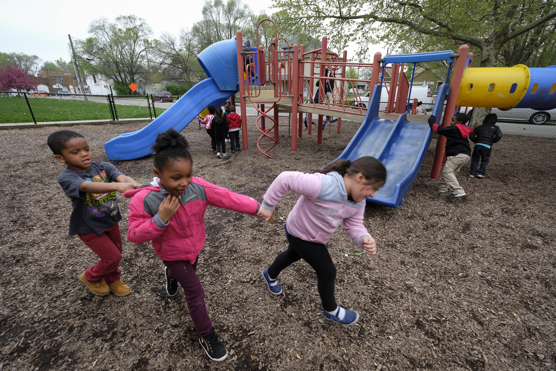Students play on the playground at Thomas Gregg Neighborhood School.