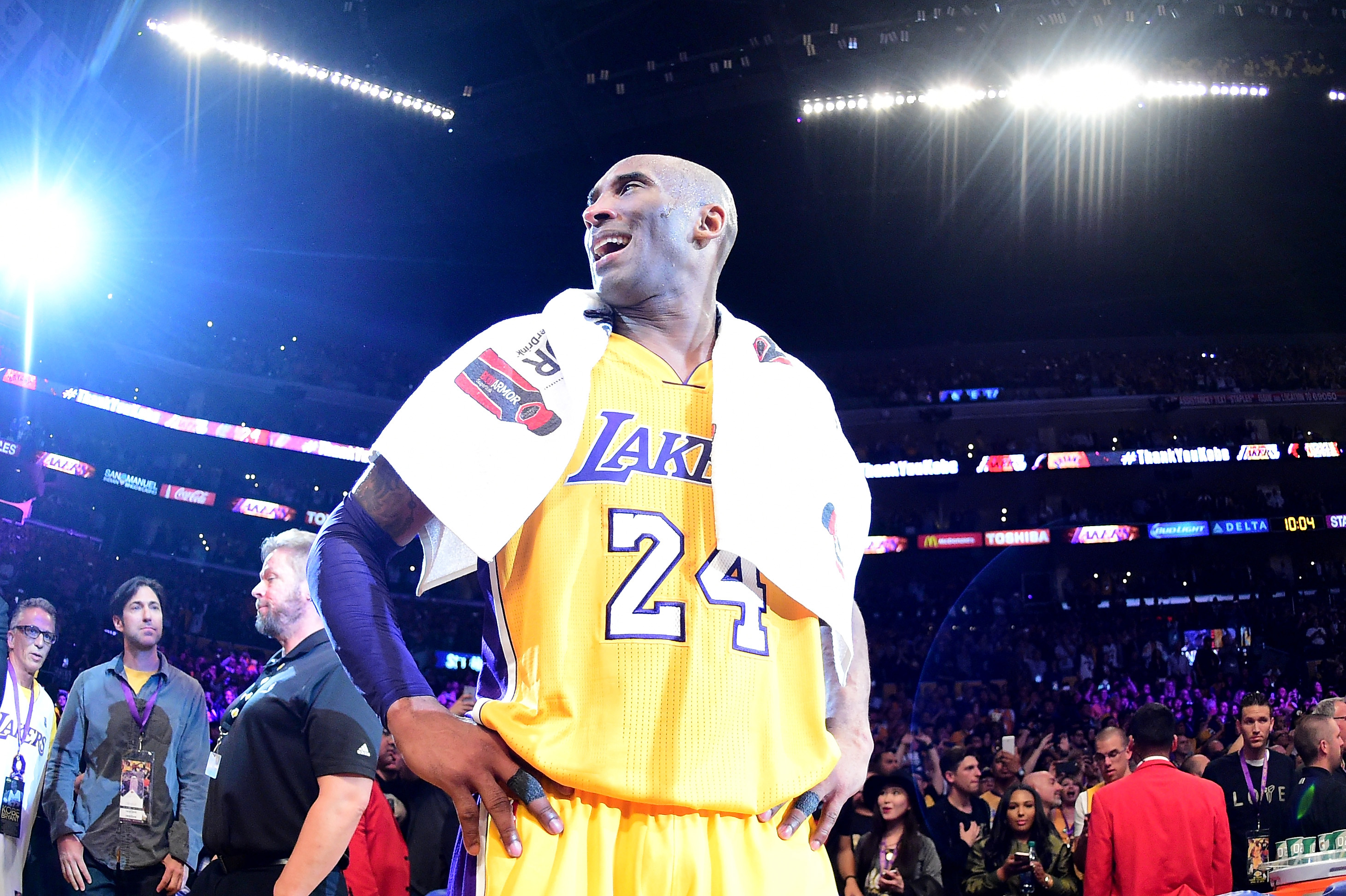 The Lakers' Kobe Bryant stands on the Staples Center court after scoring 60 points in his final NBA game on April 13, 2016. The Lakers defeated the Utah Jazz 101-96.