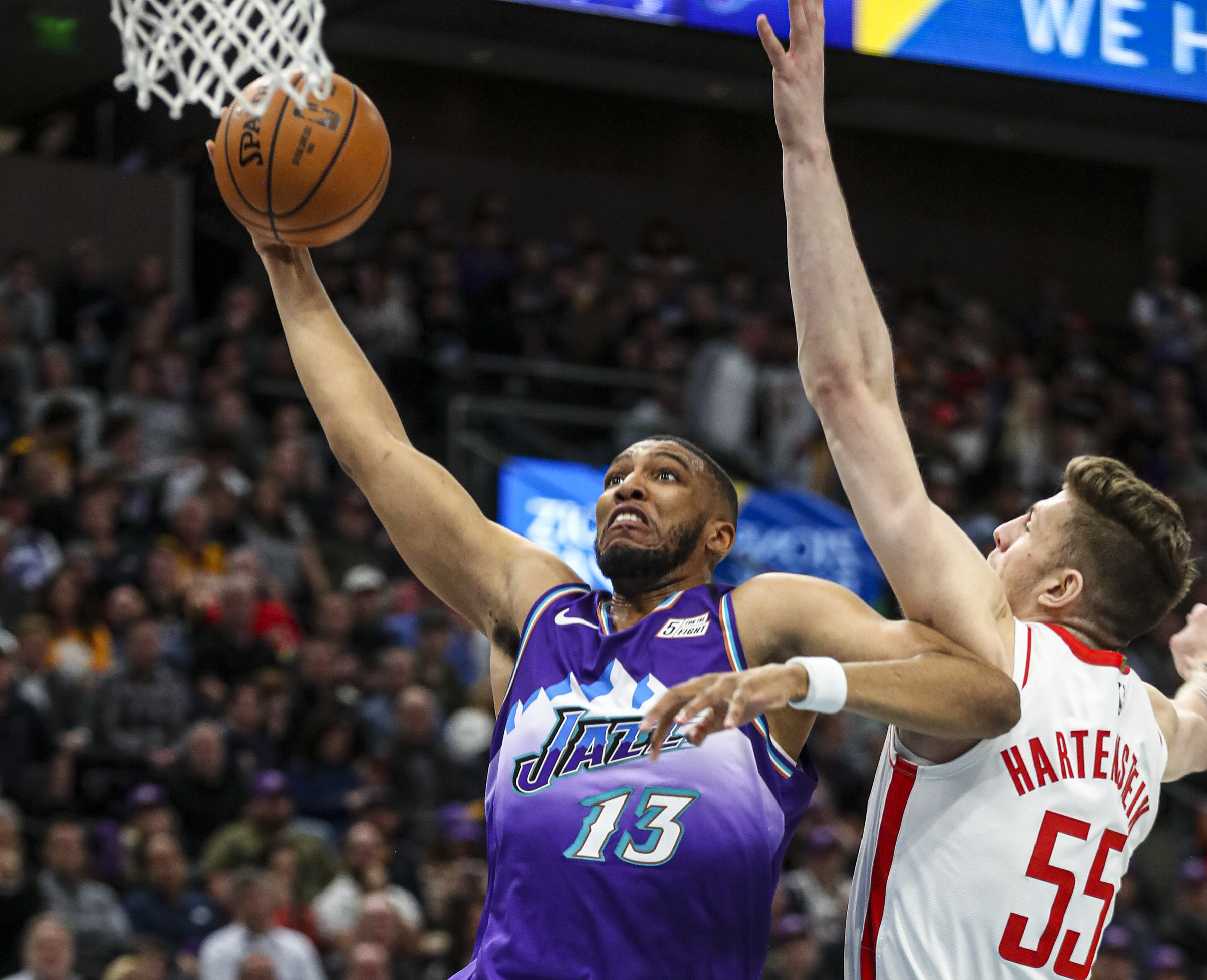 Utah Jazz center Tony Bradley (13) soars in for a dunk as he gets passed Houston Rockets center Isaiah Hartenstein (55) during an NBA game at Vivint Arena in Salt Lake City on Monday, Jan. 27, 2020.