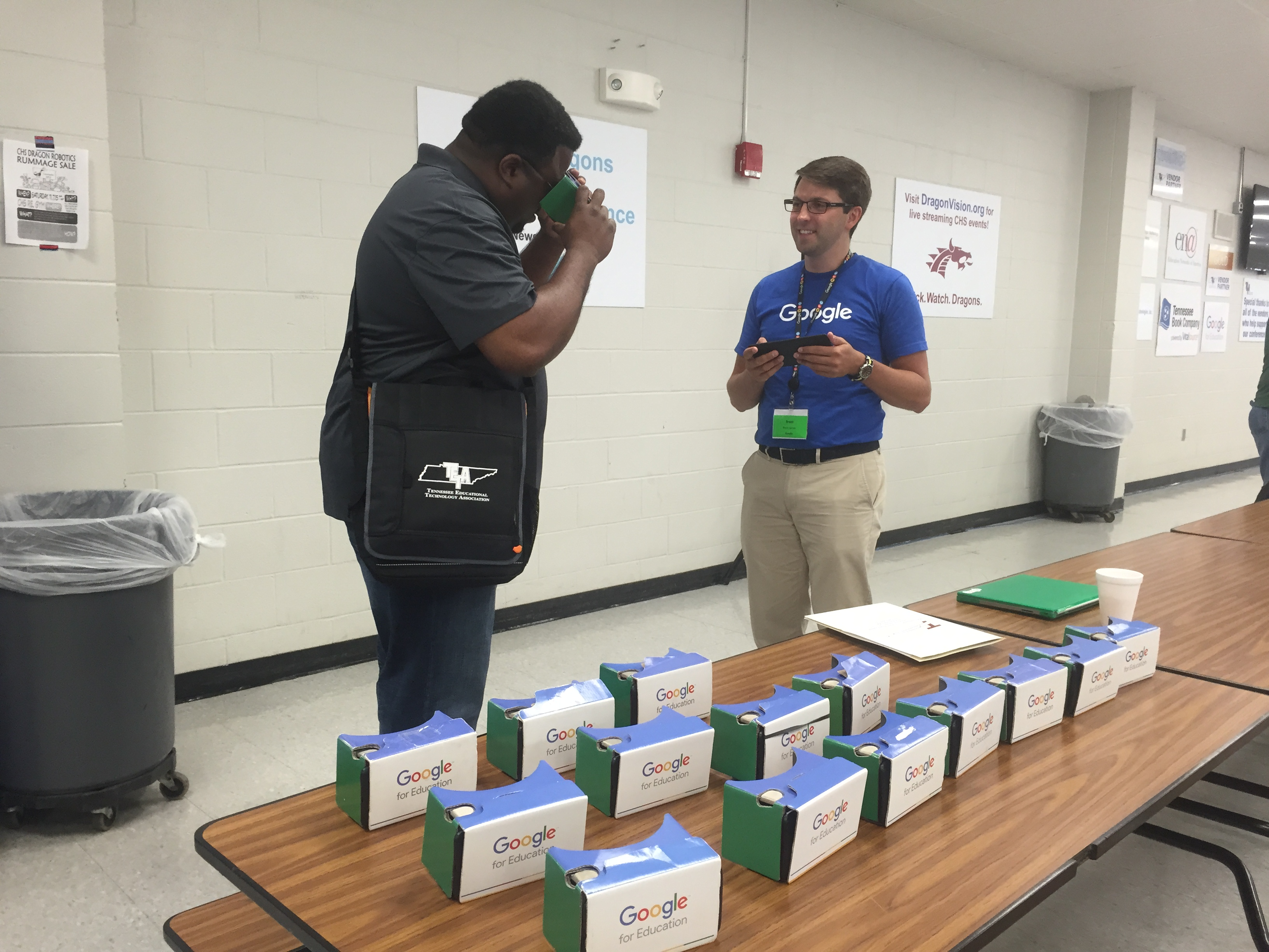 Torrence Myers, a technology specialist at Collierville High School, tries out Google Cardboard at the Tennessee Educational Technology Association's summer institute in Collierville.