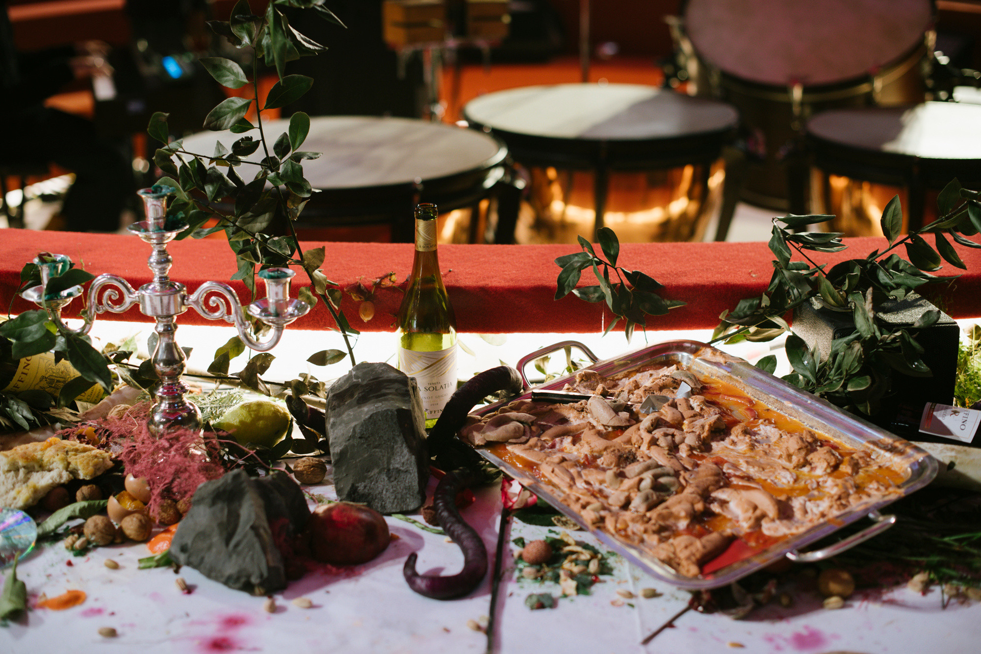 A tablescape featuring leaves, rocks and discarded food items like egg shells.