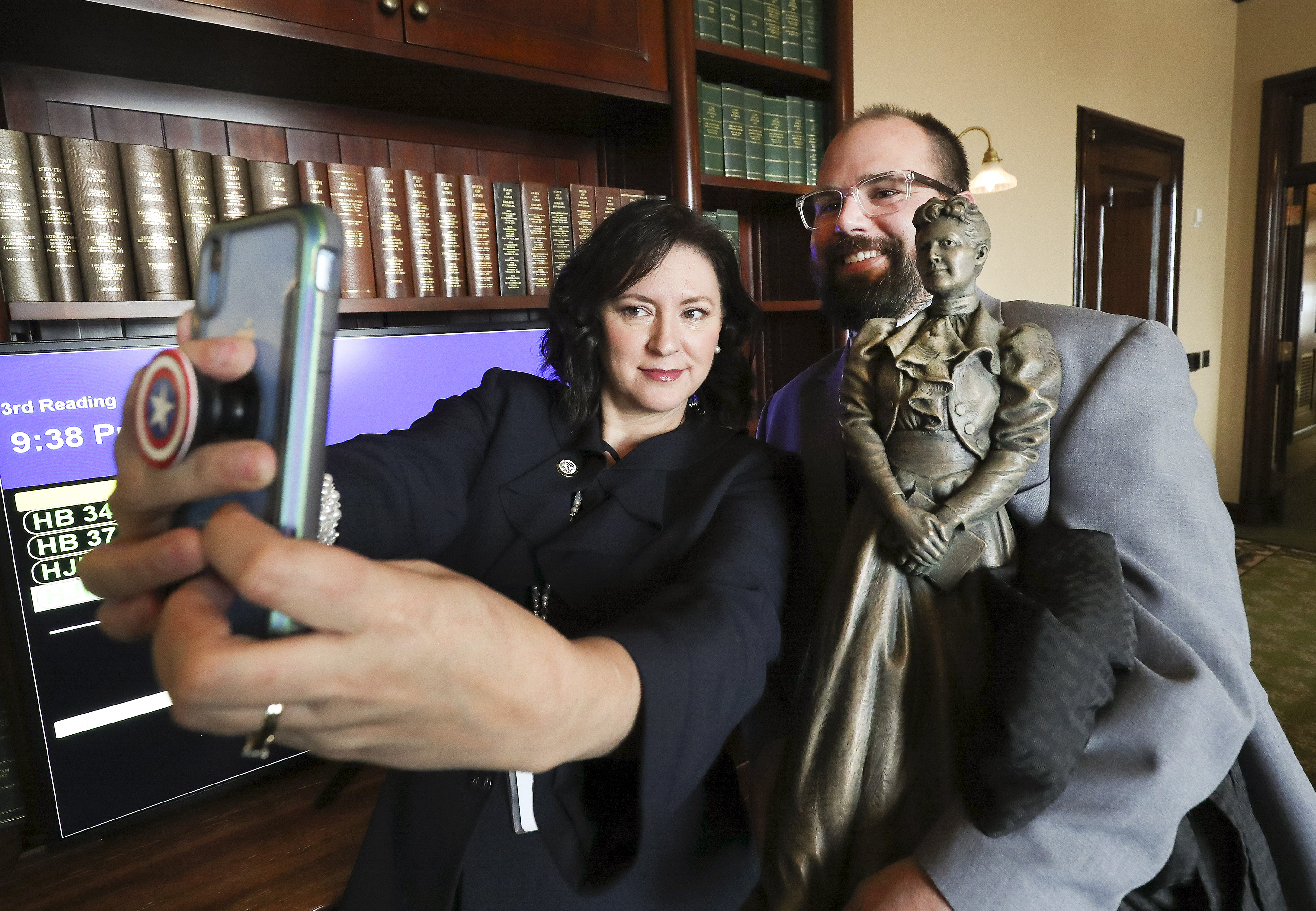 Rep. Kim Coleman, R-West Jordan, left, takes a selfie with artist Ben Hammond and his bronze statue depicting former state Sen. Martha Hughes Cannonat the Capitol in Salt Lake City on Tuesday, Jan. 28, 2020. The statue is a 25-inch replica of the 7-foot-6-inch statue that will represent Utah at the U.S. Capitol's National Statuary Hall.