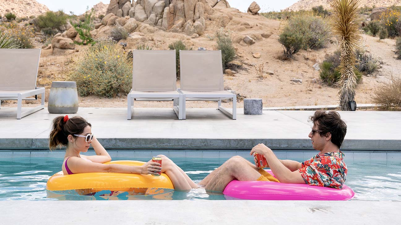 Cristin Milioti and Andy Samberg floating on pool floats.