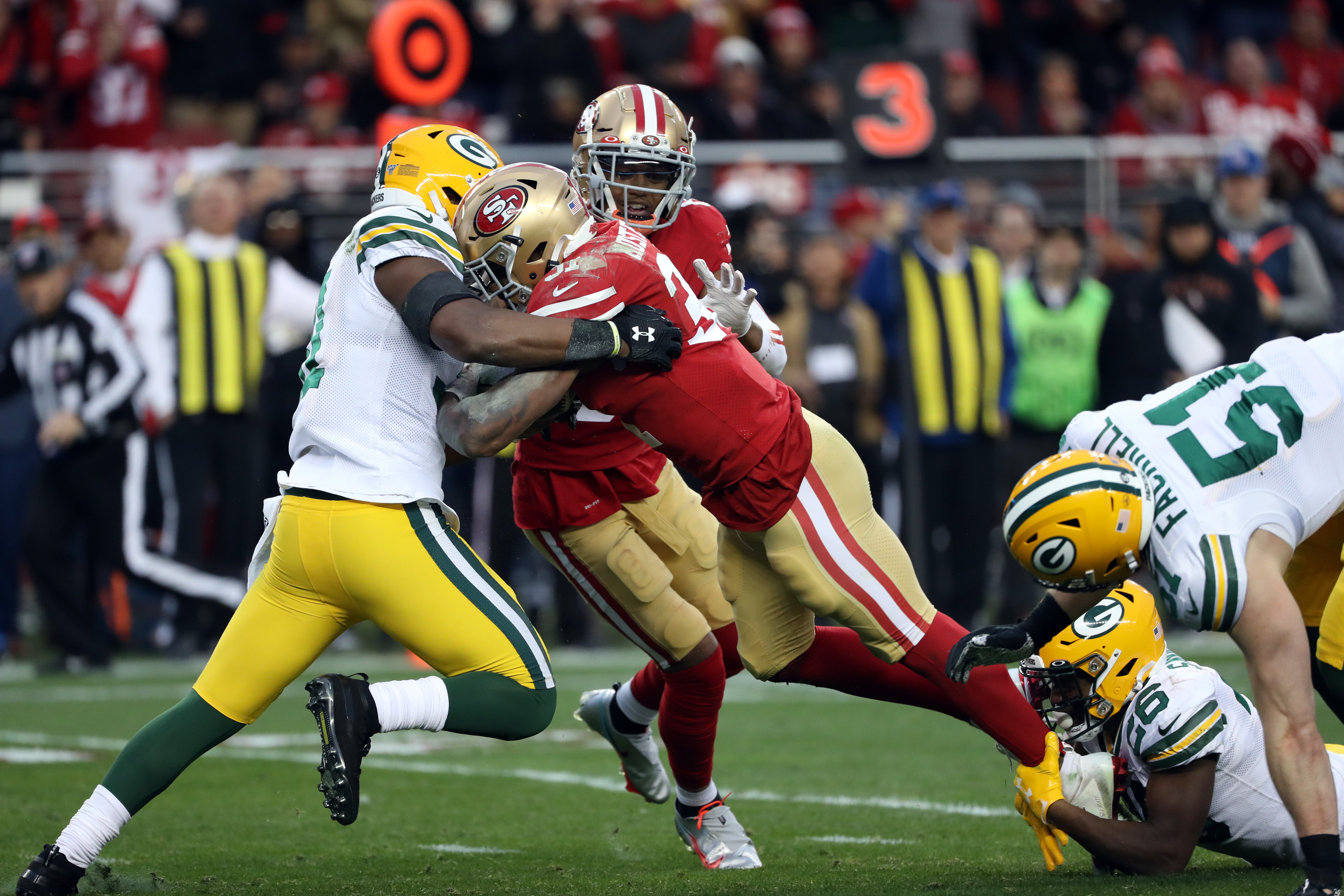 The Green Bay Packers playing the San Francisco 49ers on the football field.
