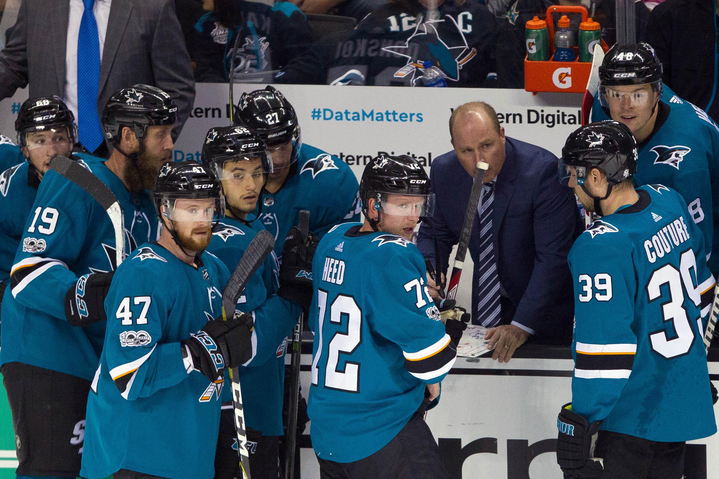 Oct 14, 2017; San Jose, CA, USA; San Jose Sharks assistant coach Steve Spott talks the team in the third period at SAP Center at San Jose. The Islanders won 3-1.