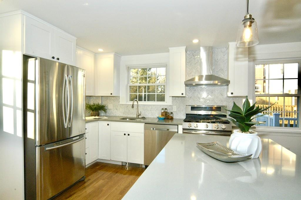 A shiny new kitchen with an island and plenty of natural light.